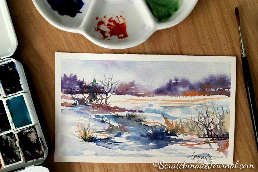Winter snow watercolor landscape using Indanthrone Blue or PB60 - ScratchmadeJournal.com