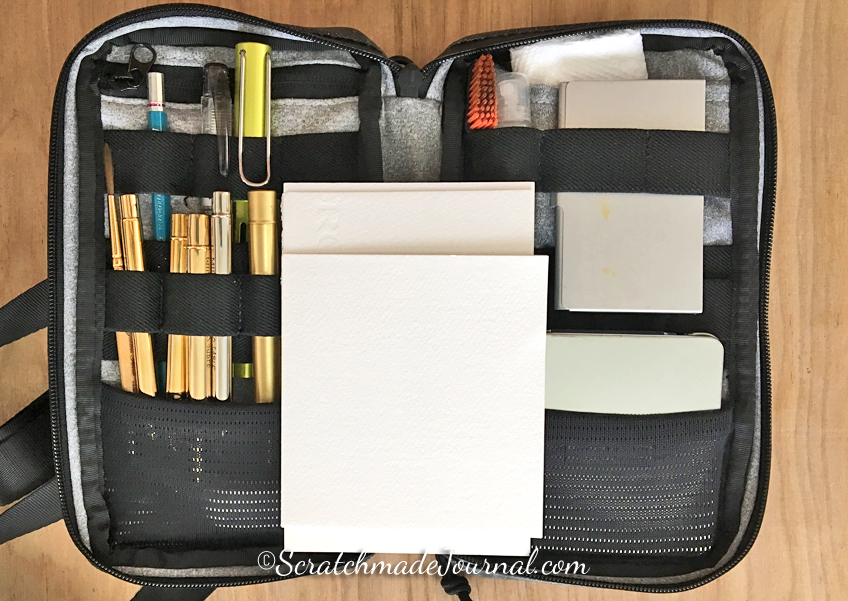The Etchr field case filled to capacity with sketching supplies weighs about 2 lbs but most of that weight is in the bag.