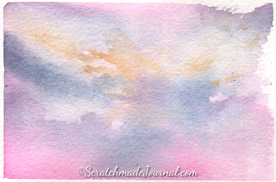 Watercolor sky & cloud painting using pink, blue and yellow - ScratchmadeJournal.com
