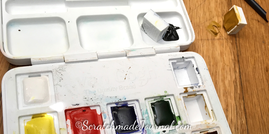 Oops! Van Gogh watercolors stay semi-moist, so even if I secure the pans, there's no guarantee that the paint will stay put.