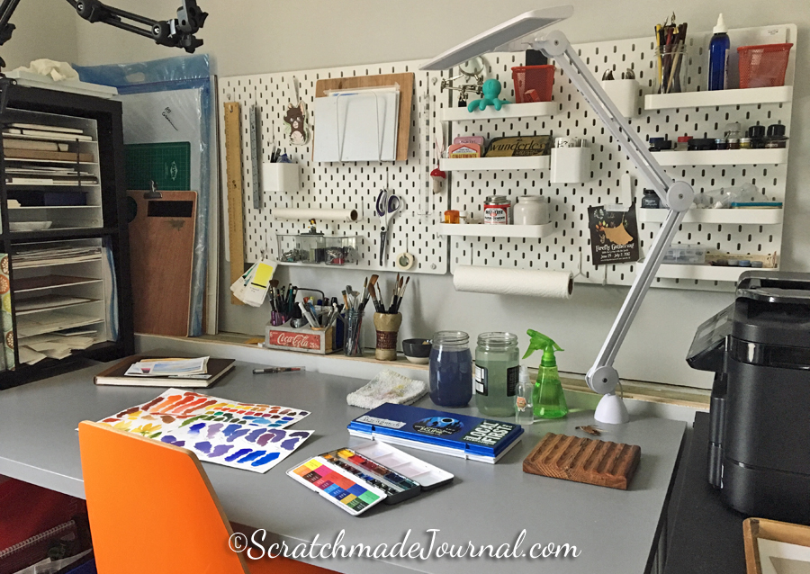 """My entire """"art studio"""" is housed along a short wall in our tiny bedroom, but it's more than adequate."""
