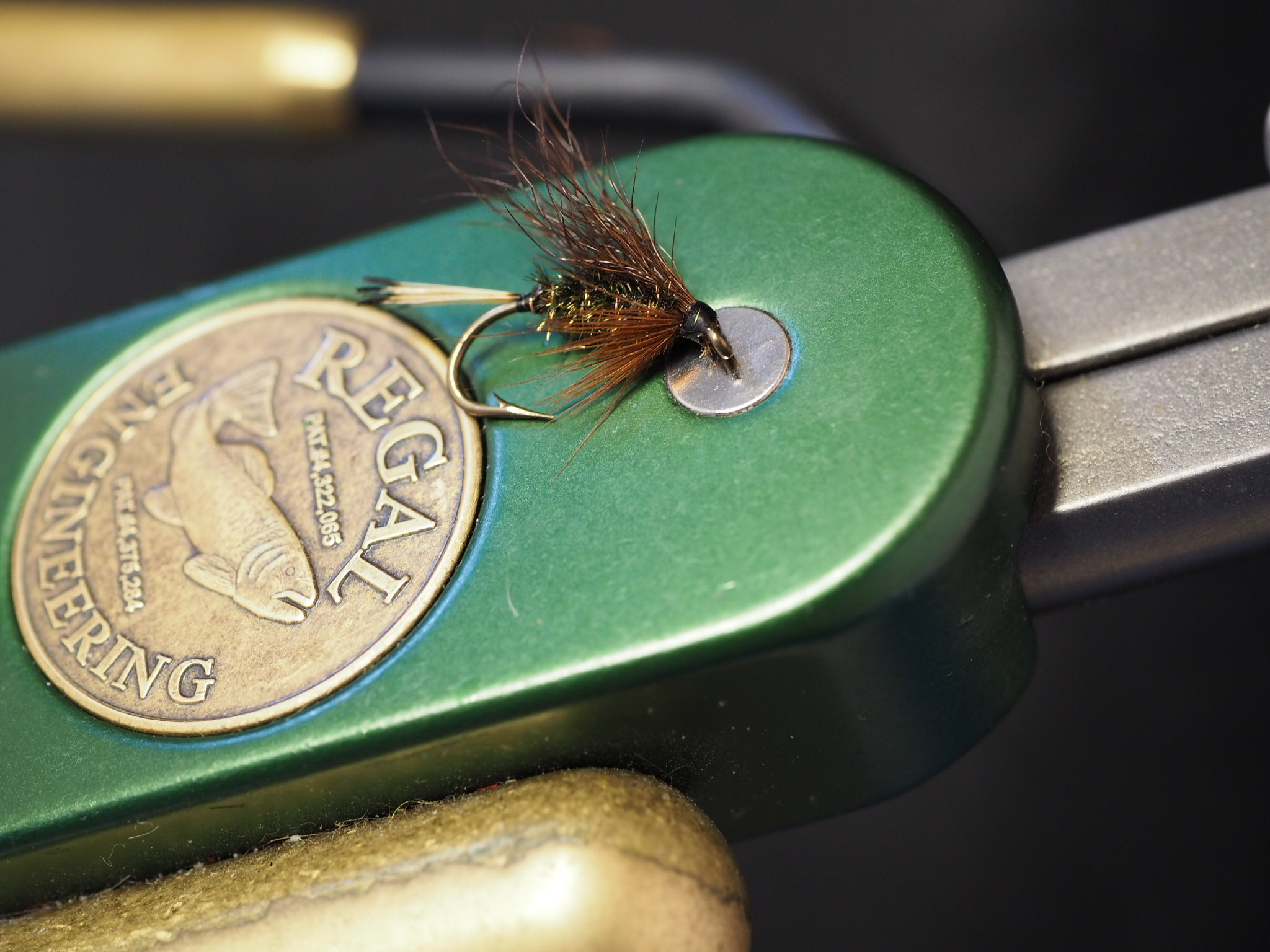 Brown wing, peacock herl body, golden pheasant tippet tail