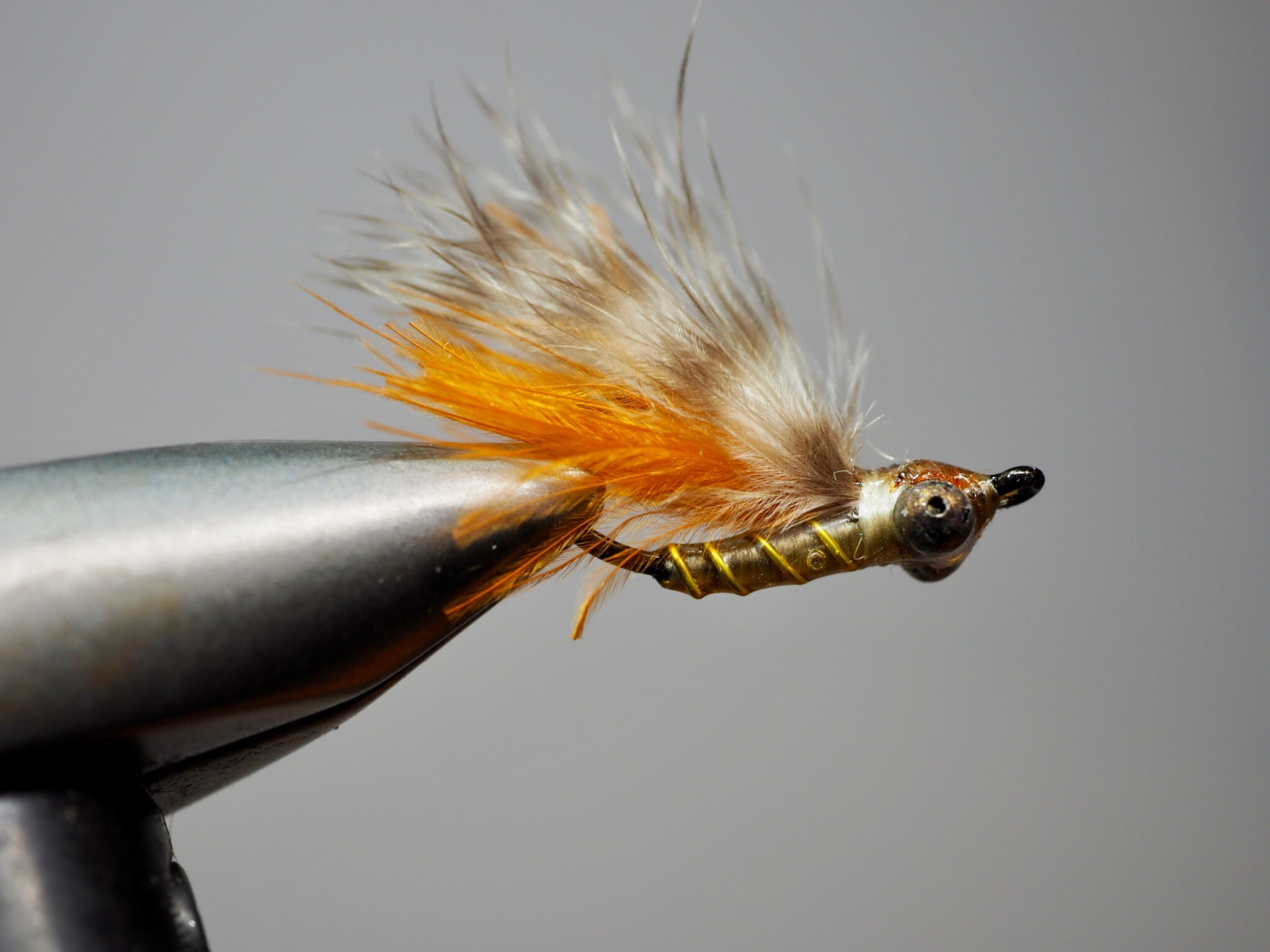 My favorite SMP is tied with a barred marabou wing.  UV resin makes this pattern bombproof, it will hold up to dozens of fish.  Tied on a Gamakatsu hook designed for bonefish (SL45), it will hold any bass that decides this panfish pattern was meant for him.