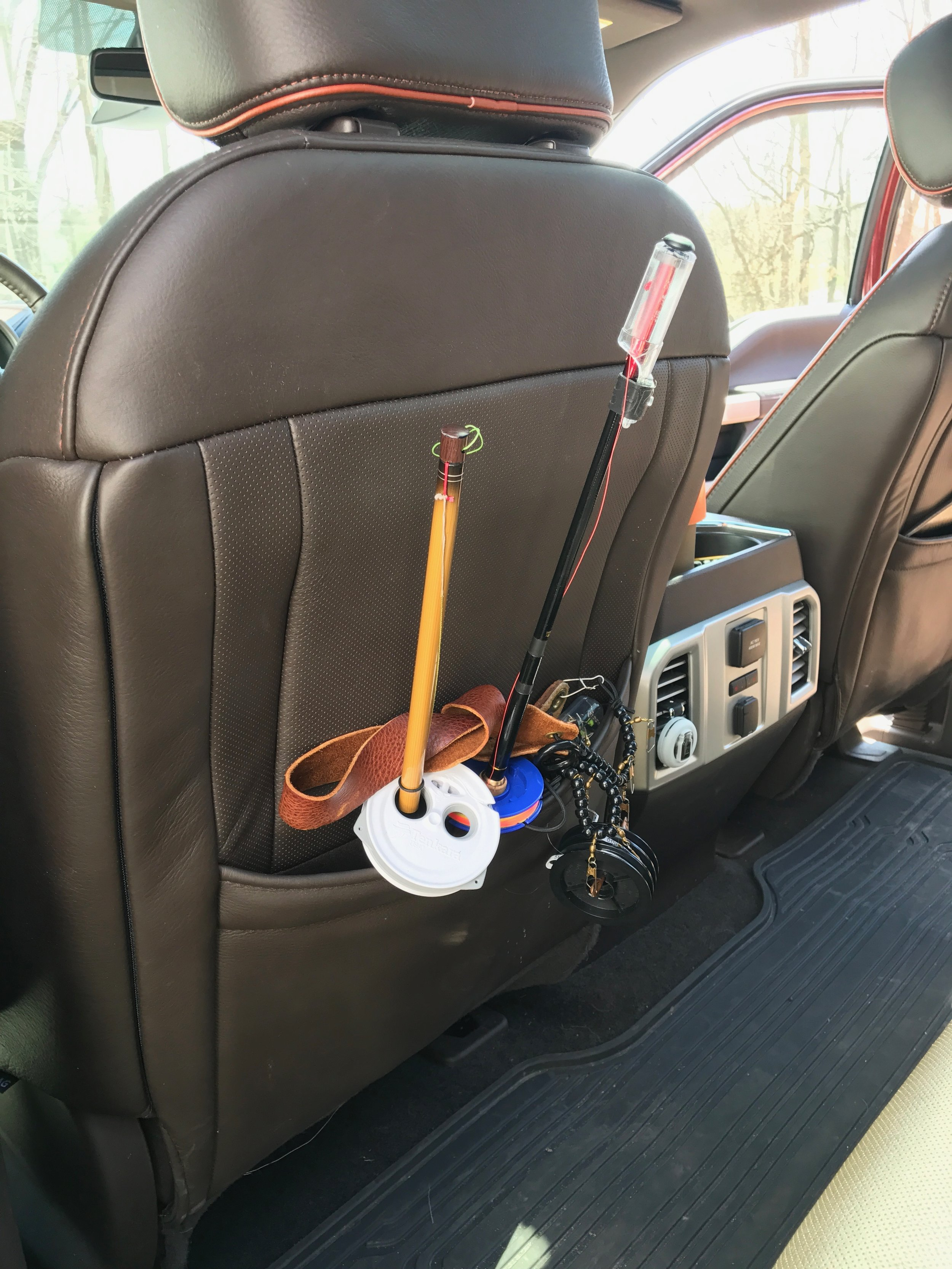 This set up permanently resides in the back of my driver's seat.  I have everything I need to take a few quick exploratory casts on a new piece of water.