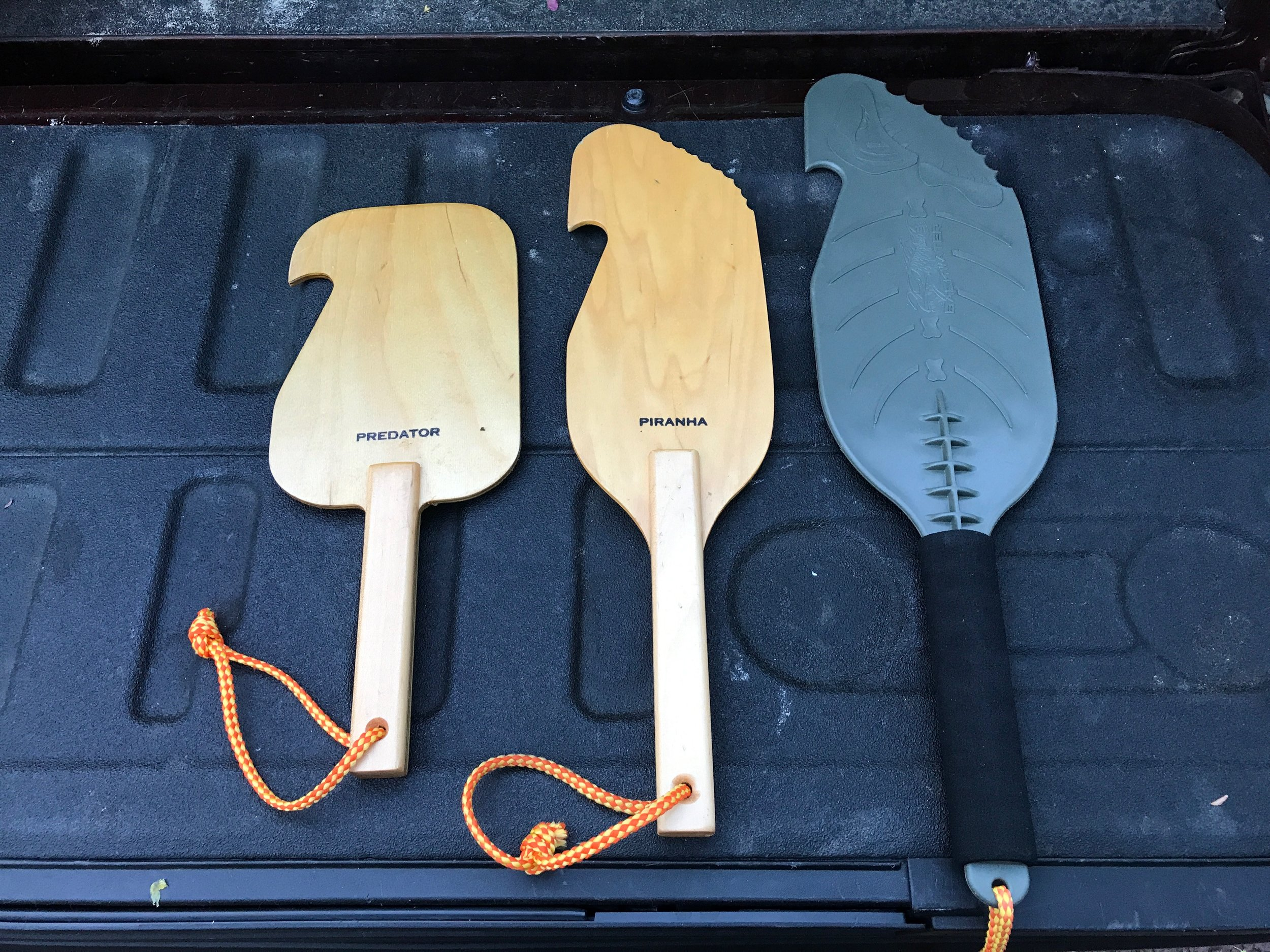 My collection of hand paddles.  From left to right the Predator, the Piranha, and the Assault had paddles.