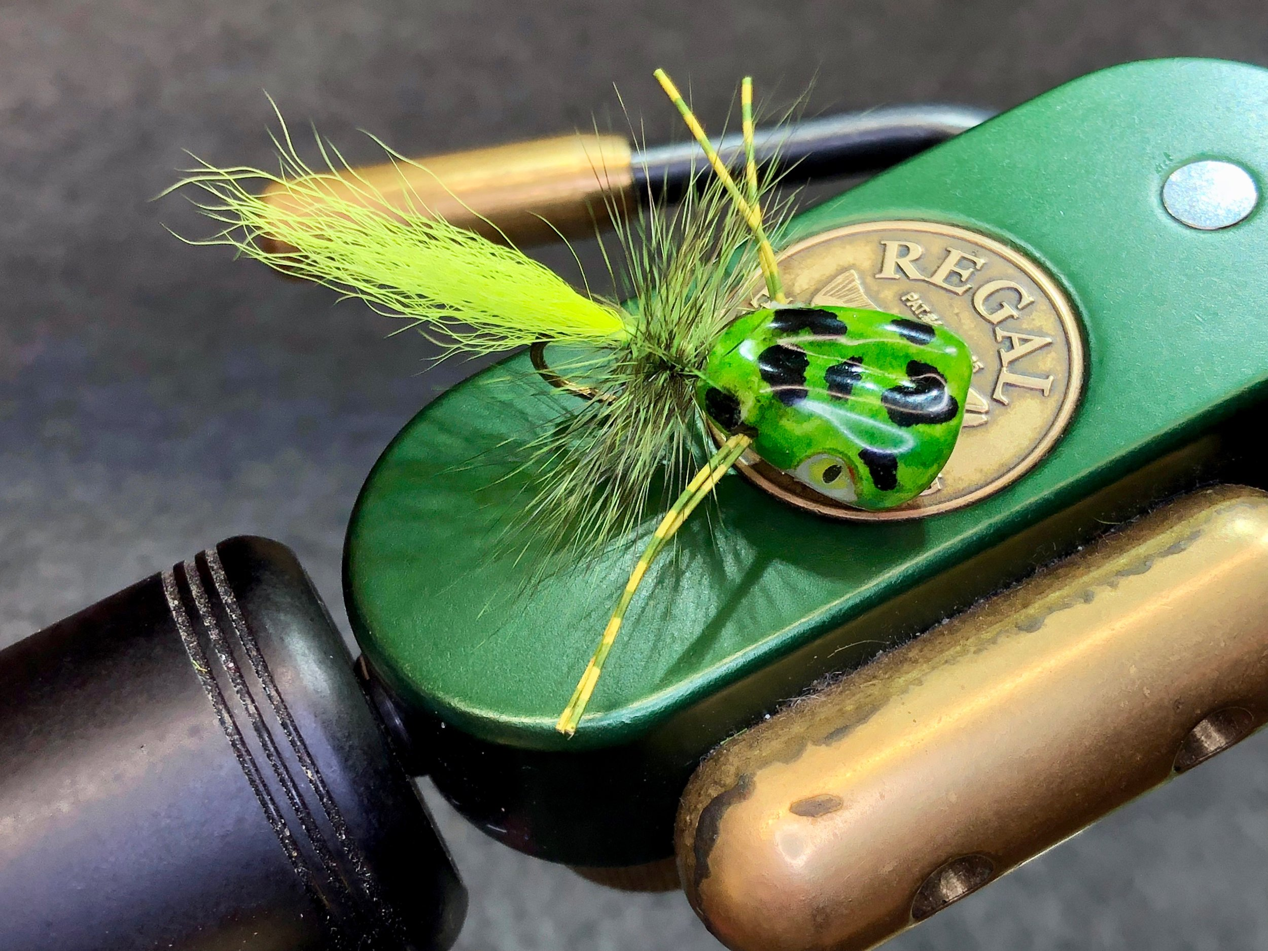 A not so simple, frog colored, popper made from a white Seaducer Double Barrel Popper body from Flymen Fishing Company. The preformed body and the perfectly matched hooks and eyes make tying great looking poppers a breeze.