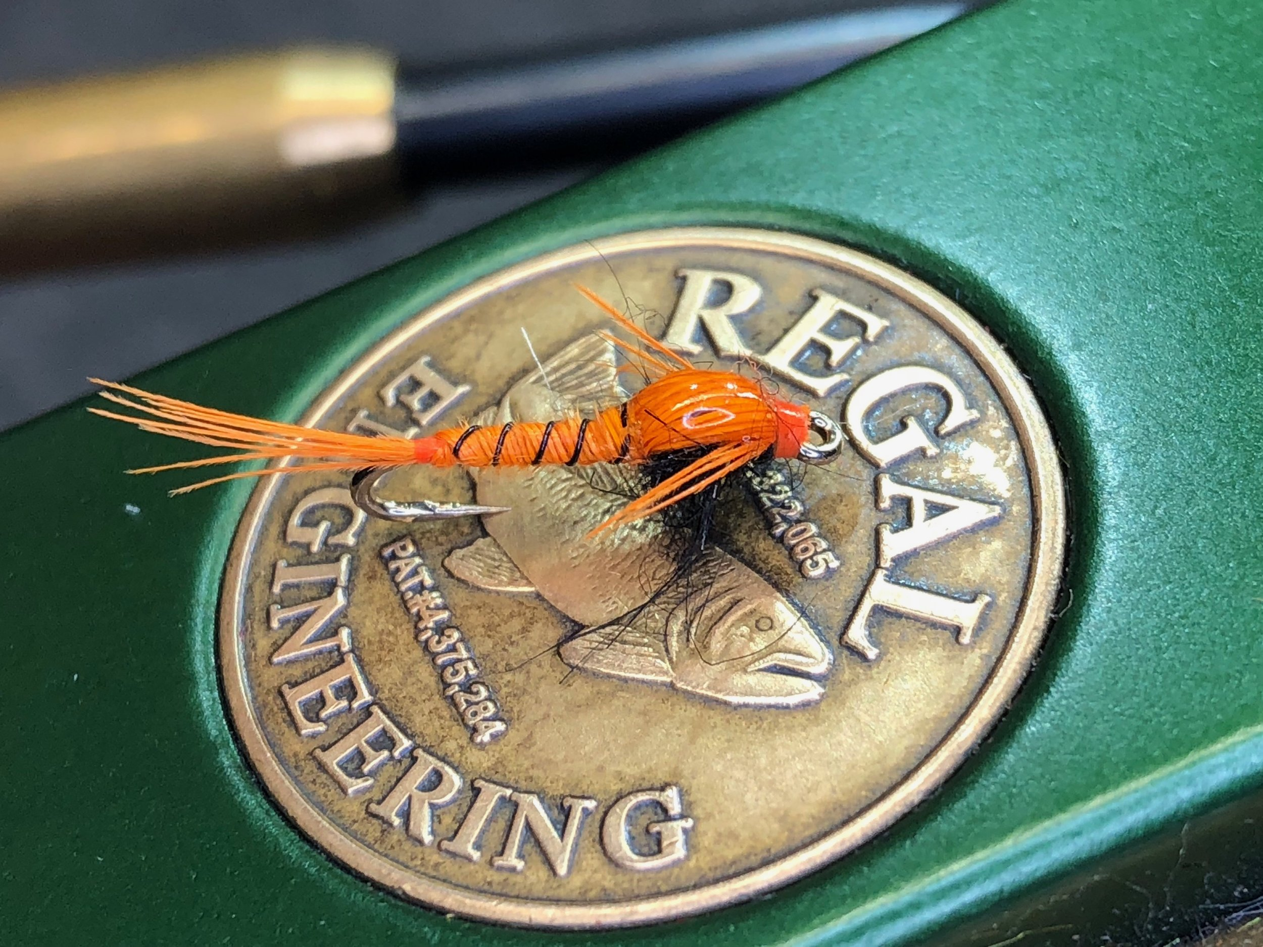 The Panfish Pheasant Tail Nymph swaps out natural pheasant tail fibers for some dyed flourescent orange.