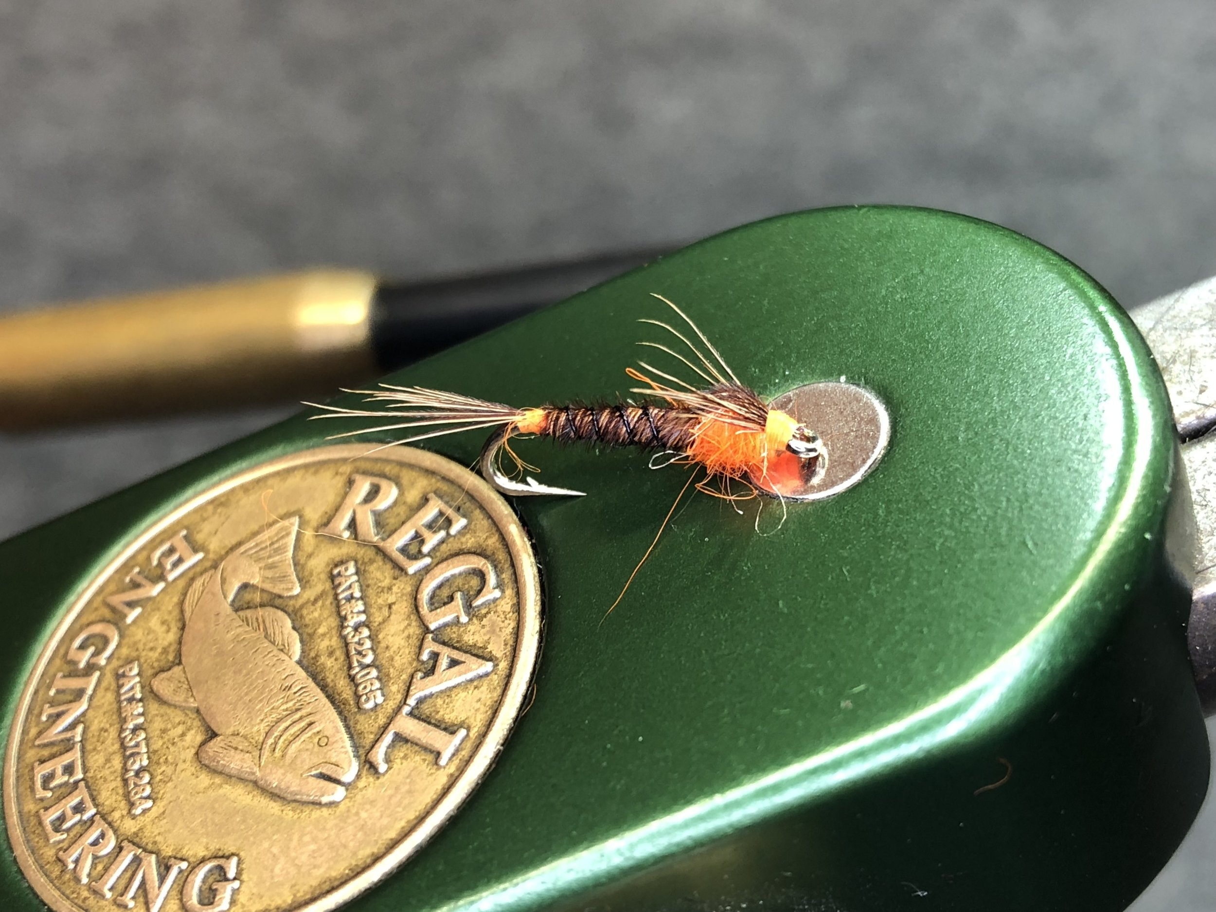 Another version of an orange pheasant tail nymph, this one borrowed from one of my trout boxes. Hot spots fore and aft make this fly particularly attractive to autumn brown trout, but it would also work well on panfish.