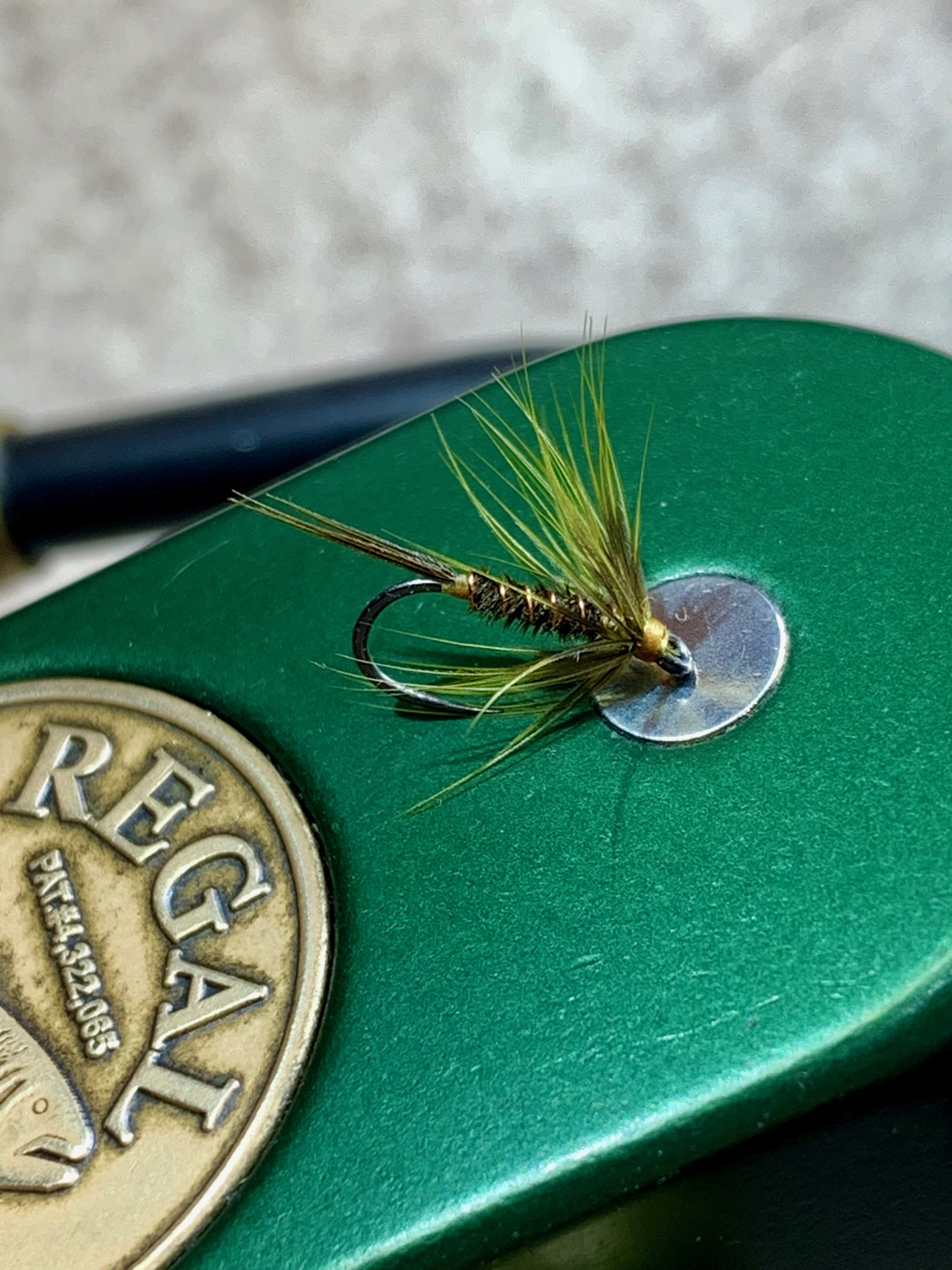 Small flies like this size 16 olive soft hackle can be deadly on winter panfish.