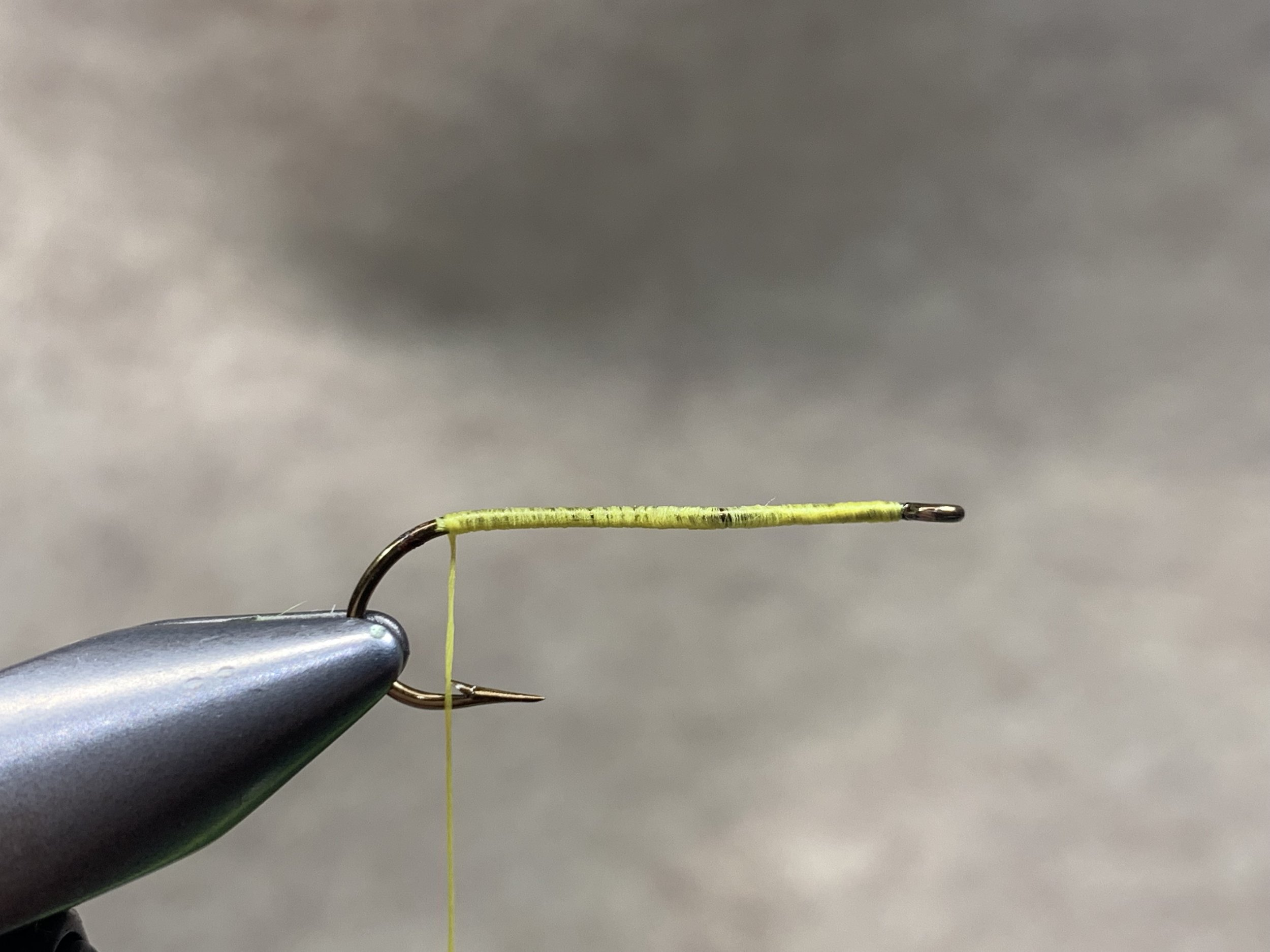 Step 2 - Attach your thread near the eye of the hook and wrap back towards the bend stopping just over the barb.