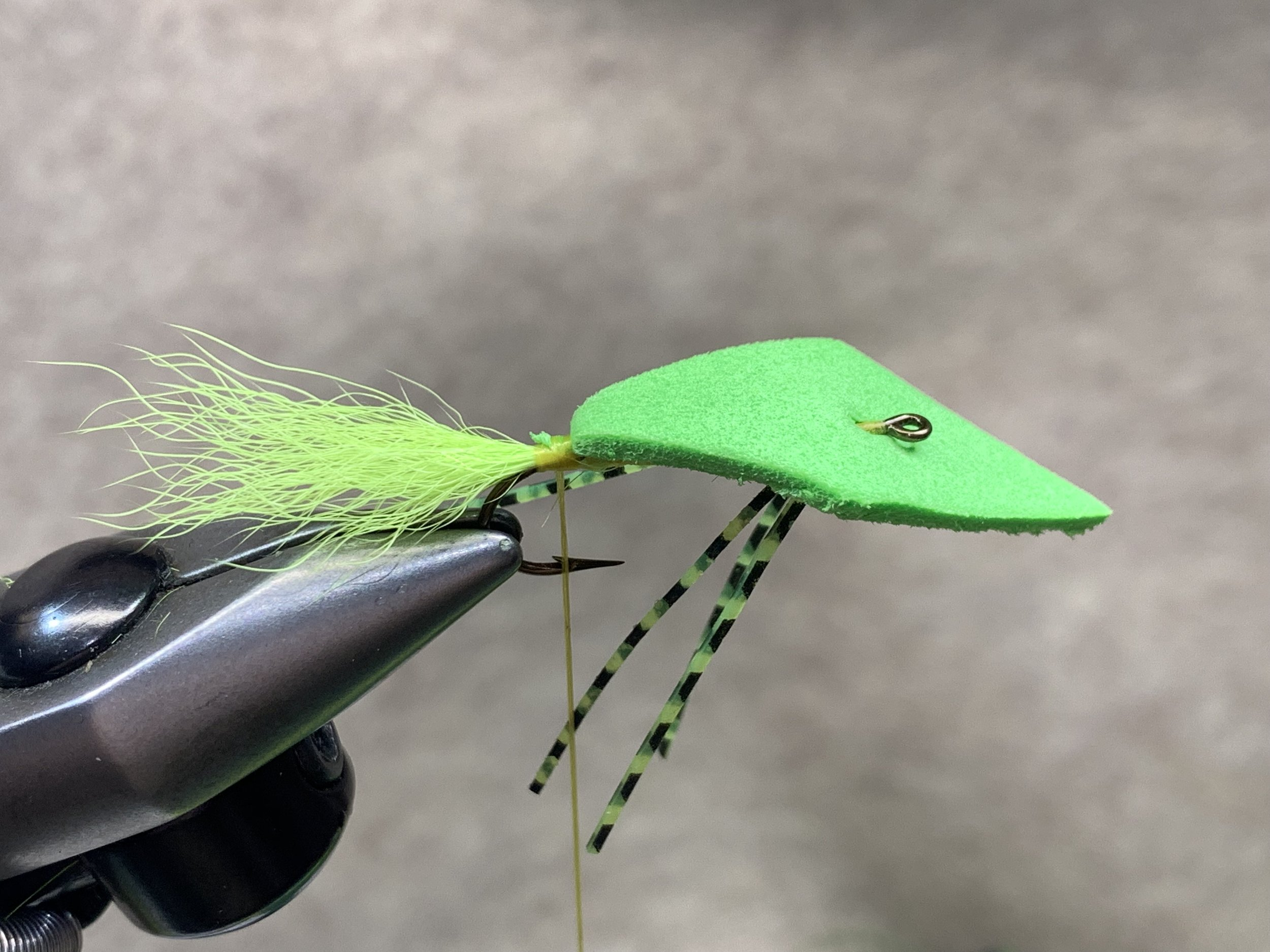 Step 10 - I tie on a rotary fly tying vise (a Regal Revolution) so I secure the top edge of the foam first because I can rotate the vise to get access to the bottom of the fly. If tying on a non-rotary vise you may want to secure the bottom edge first to make finishing the fly easier.