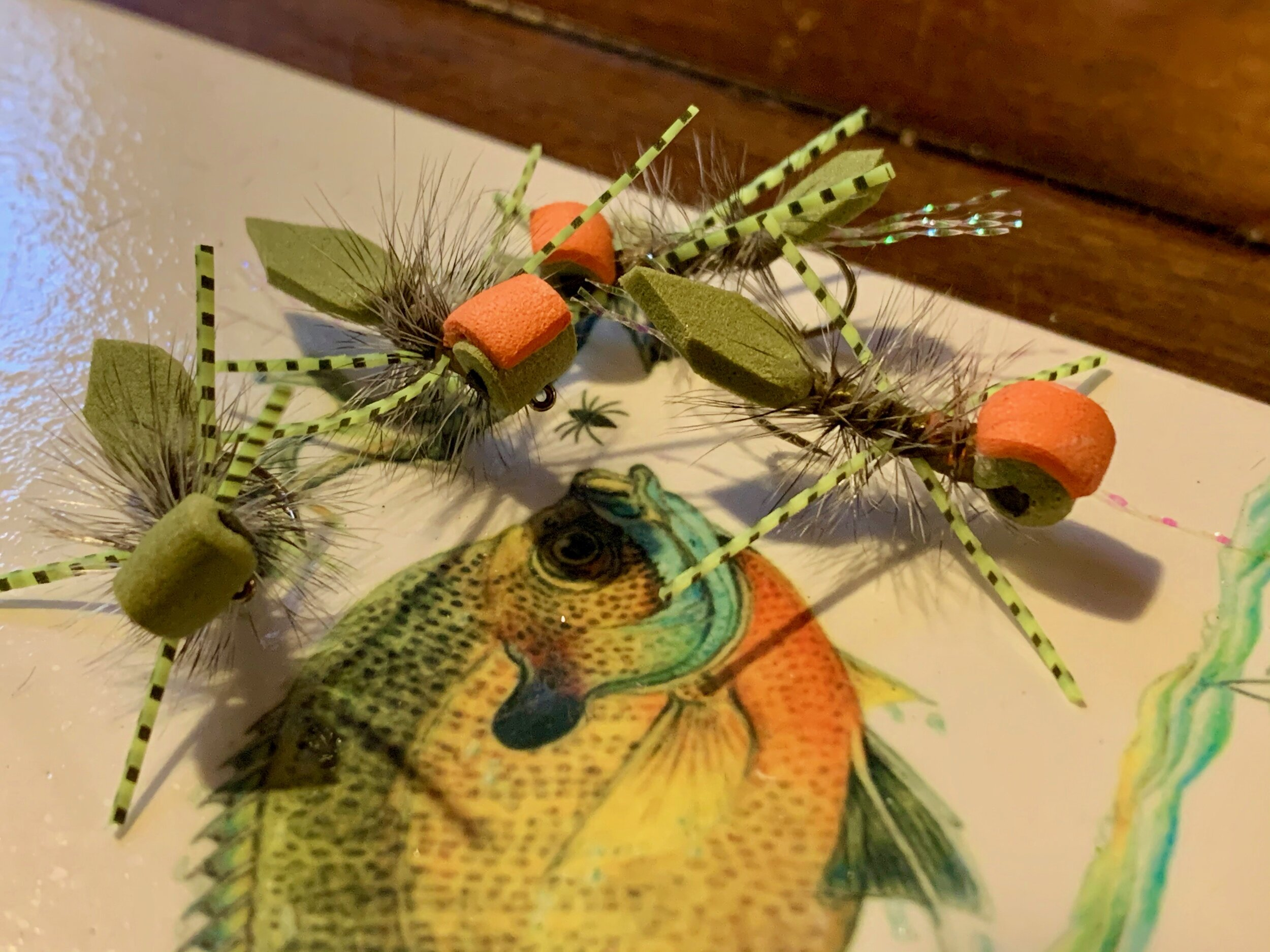 Olive Micro Gurglers with black foam eyes. You can see how the addition of a brightly colored indicator would help the angler see the fly on the water!