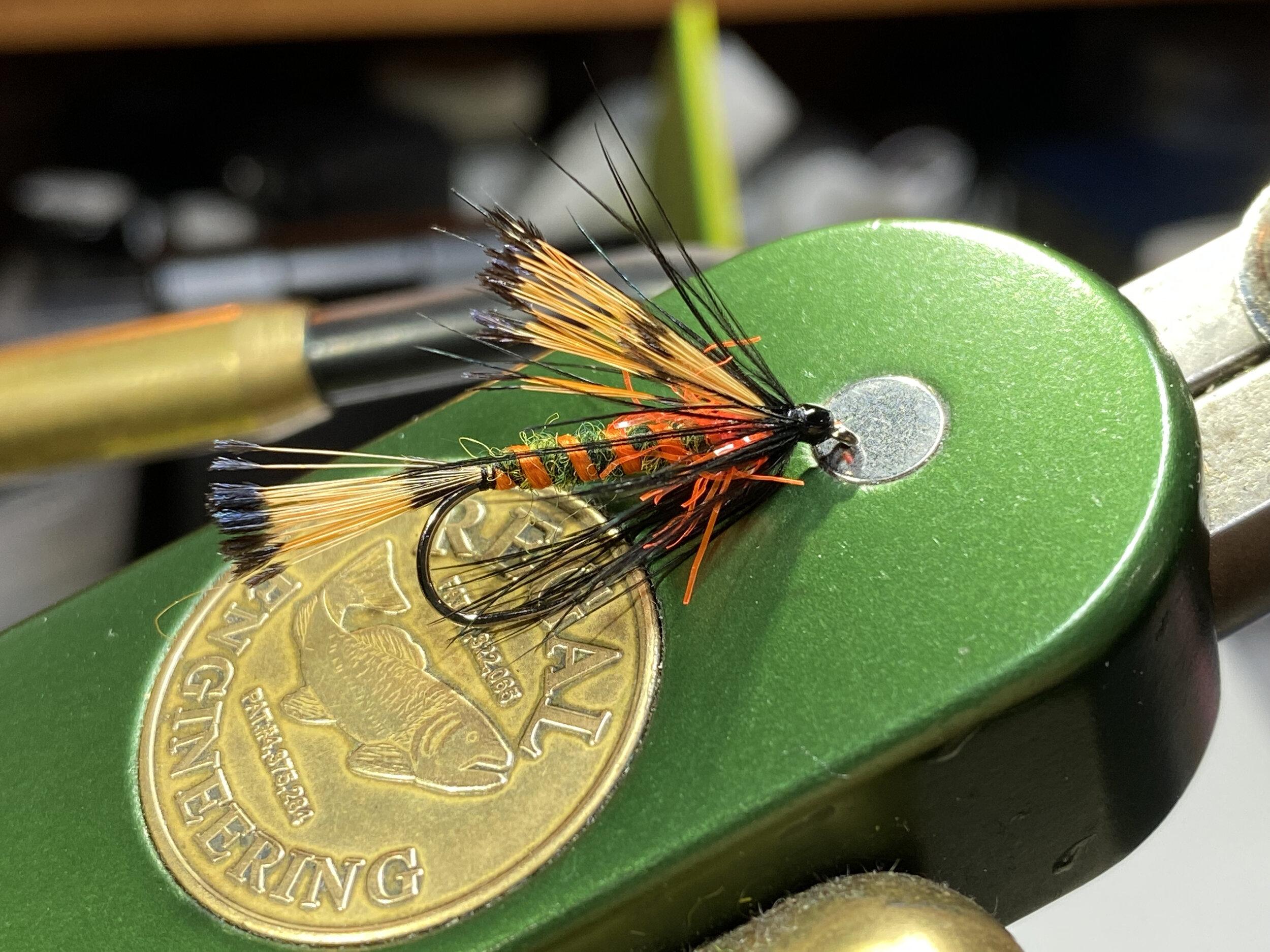 The Panfish Pazooka tied streamer style.  Fl. Orange Straggle String makes a great hotspot.