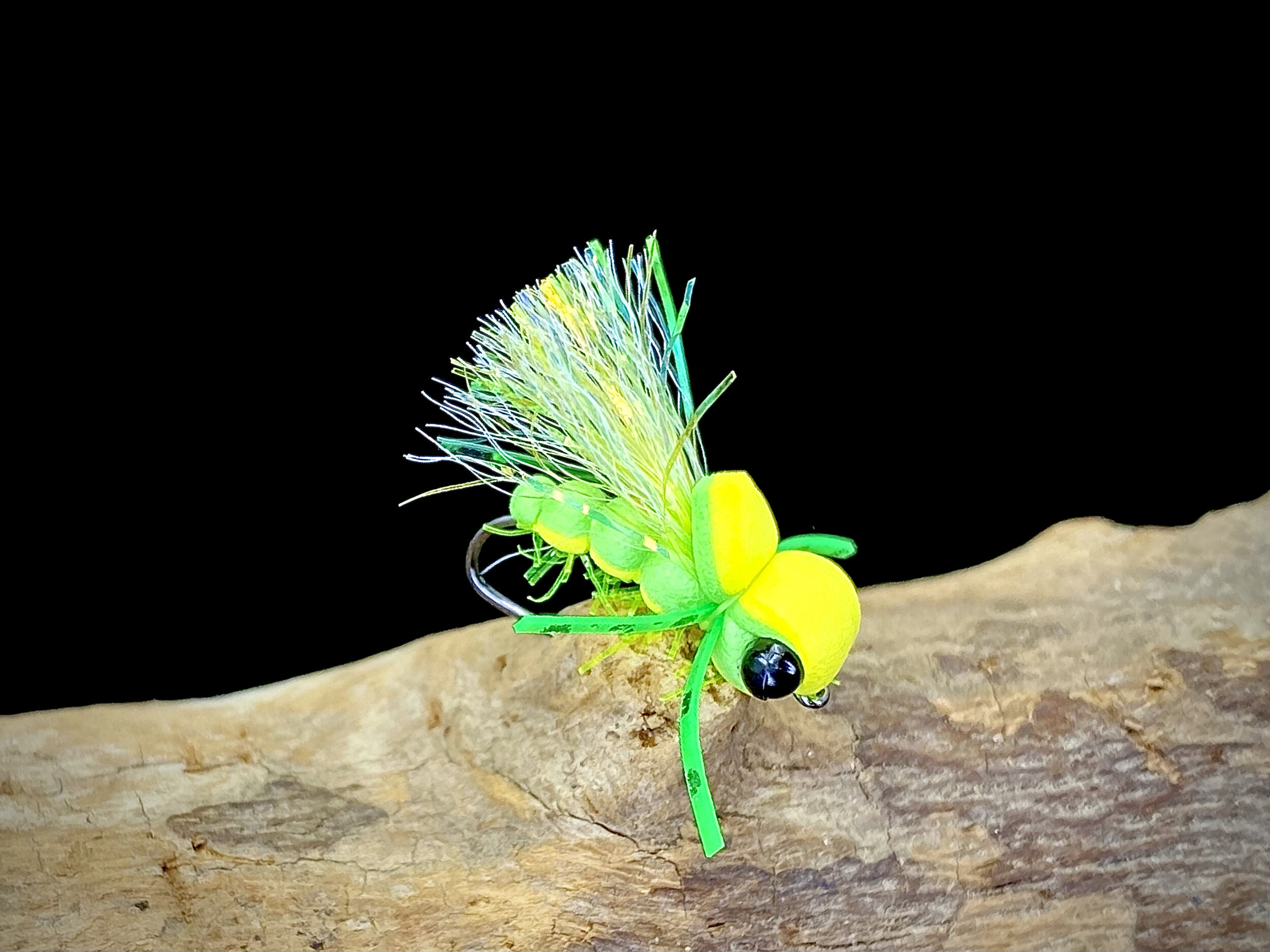 Brighten up the colors, swap out the knotted legs for rubber and add a wing and you have a great looking topwater bug!