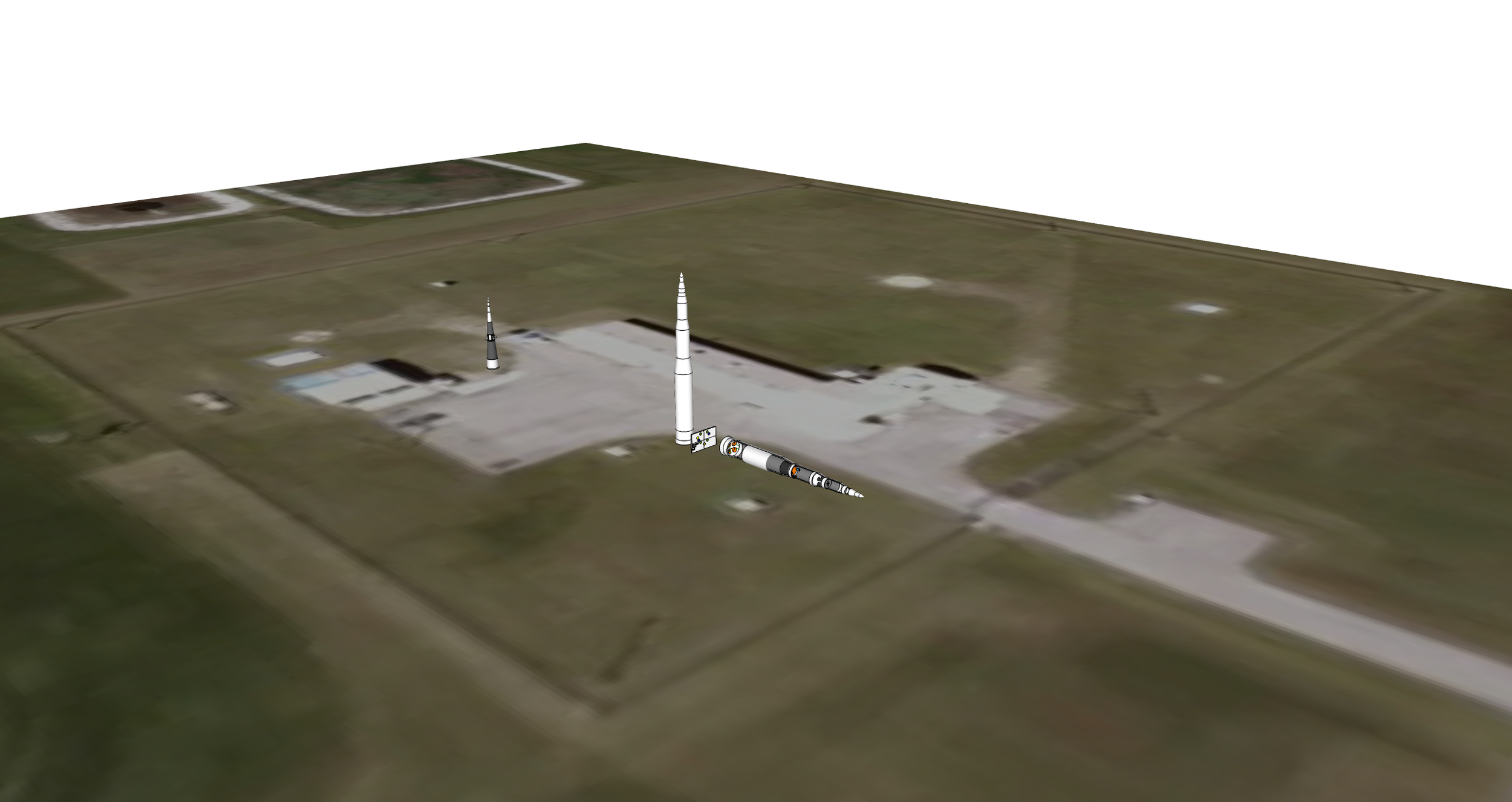 A satellite view of the museum with two artifacts (standing) added and an entertainment/educational piece laid on the ground.