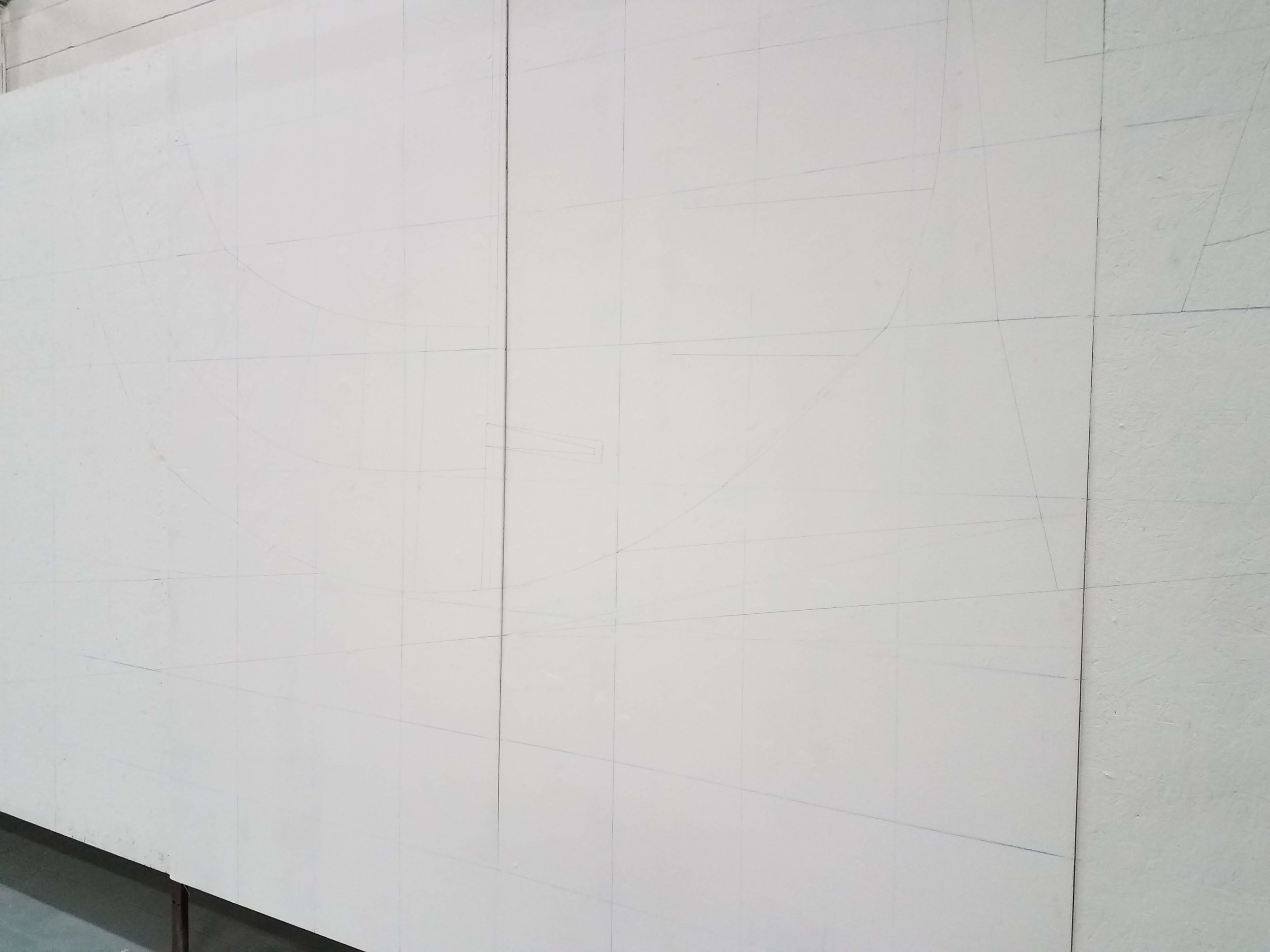 For accuracy, Chris created a grid of chalk lines and drew the outlines of the mural for his volunteer.