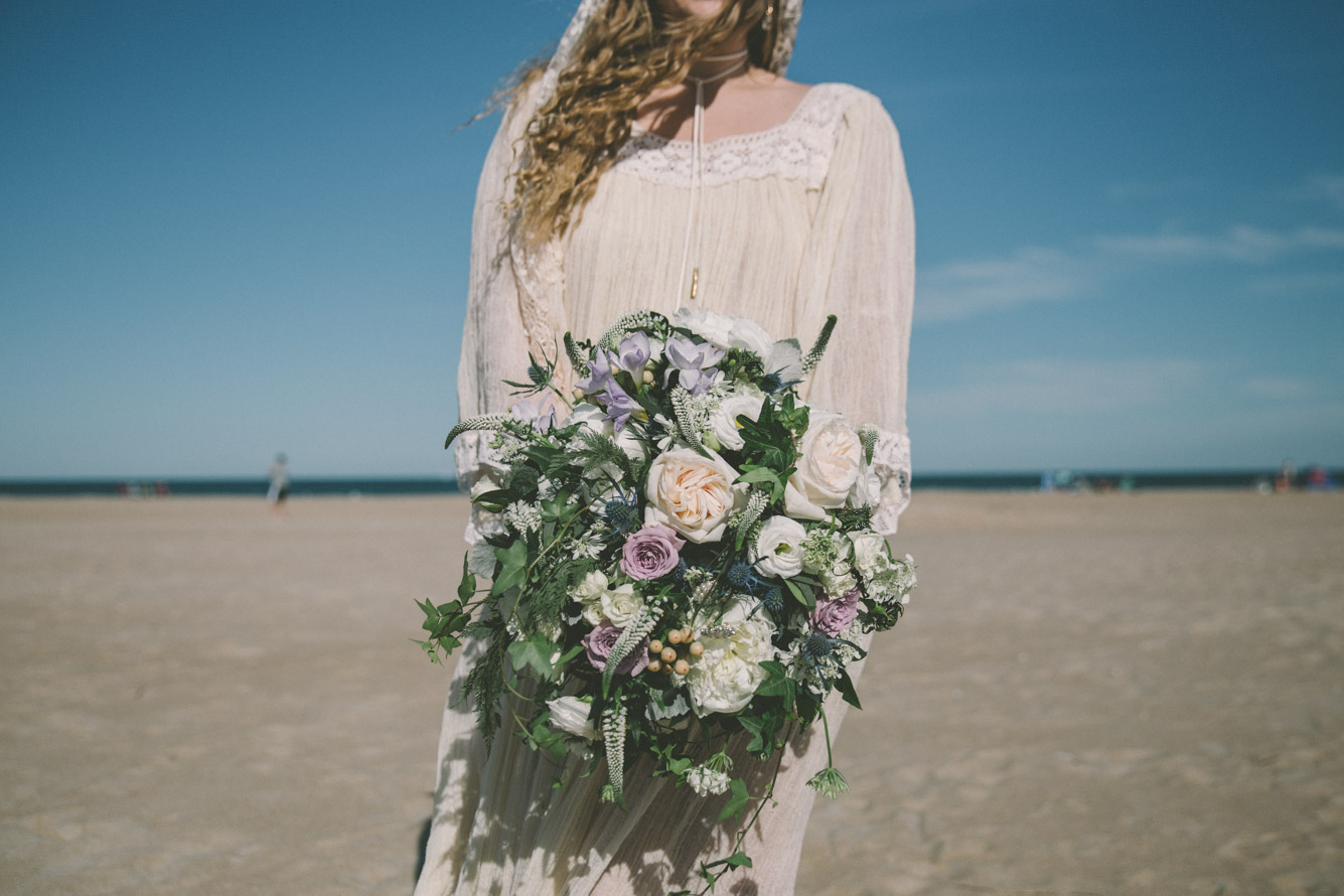 bride big bouquet beach.jpg