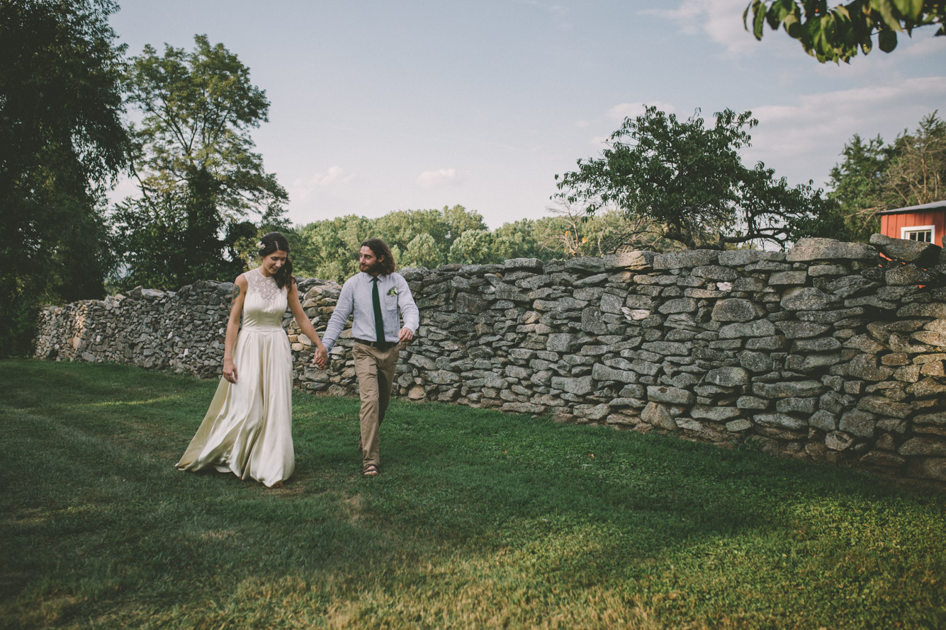 bride and groom steppingstone museum walking holding hands.jpg