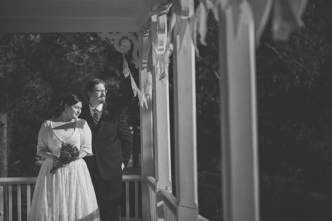 cherry hill farmhouse bride and groom on the porch.jpg