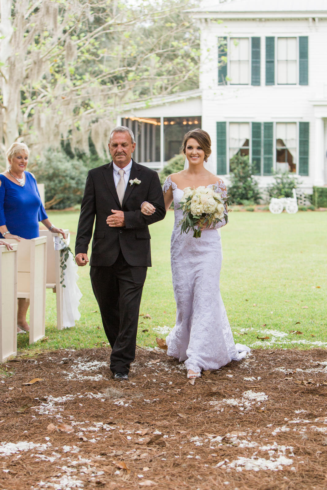 Bride walking down the aisle during outdoor wedding at The Glen Venue, The Linwood in Glen St. Mary, Jacksonville wedding venue