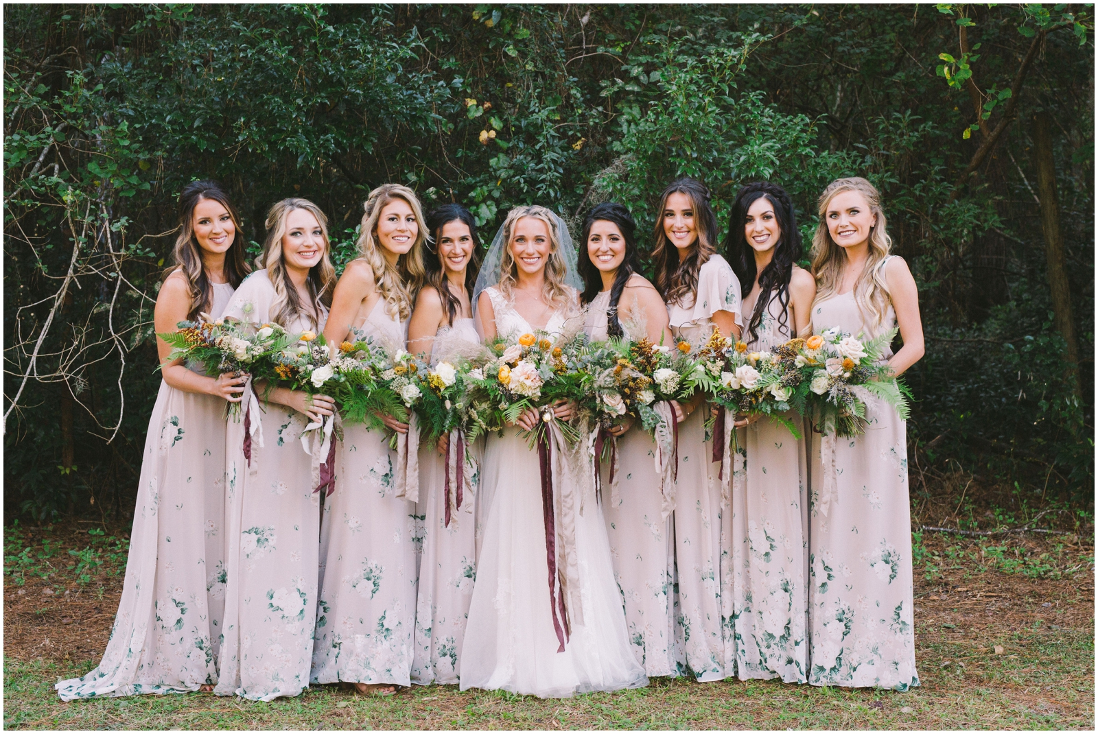 Bride and bridesmaids holding bridal bouquets