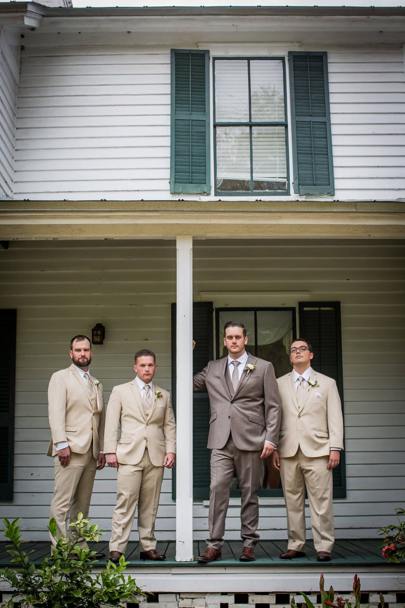 groom and the groomsmen in front of the glen venue