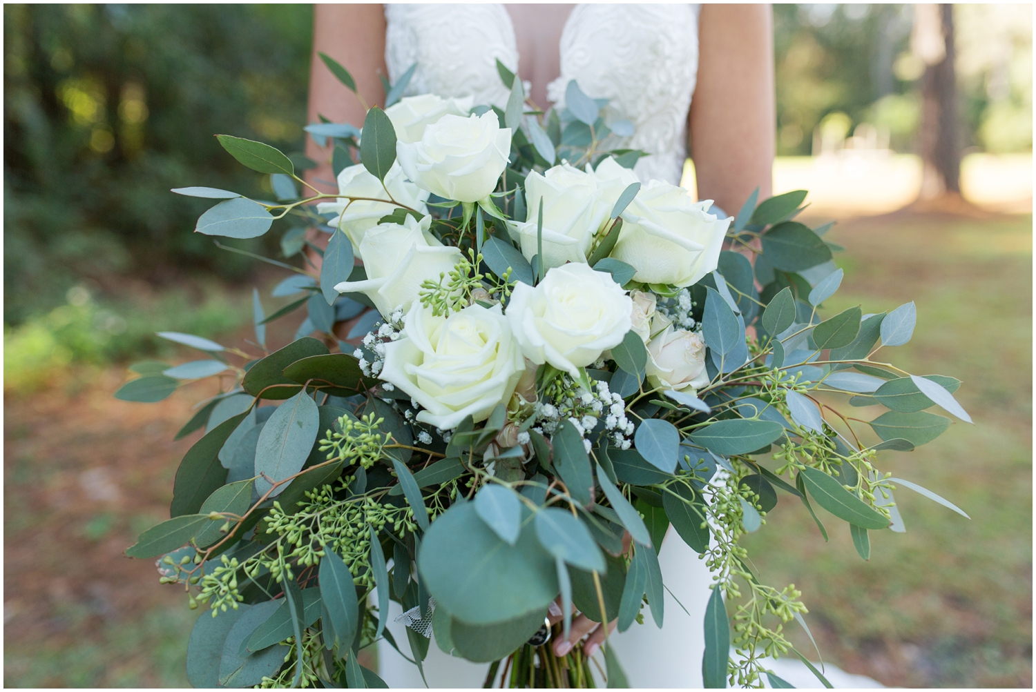 Bride's greenery and white wedding bouquet