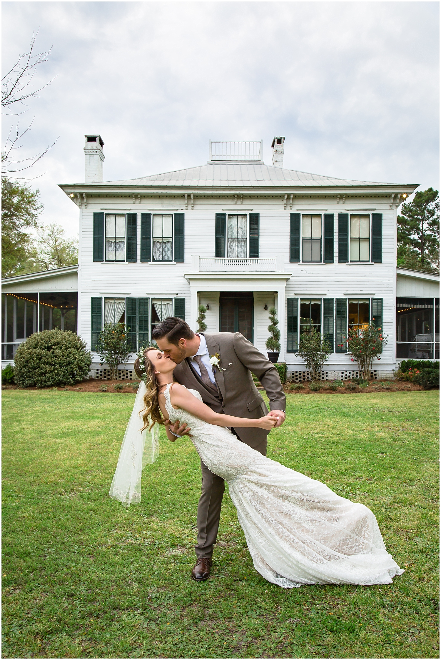 bride and groom in front of the Glen Venue in North Florida
