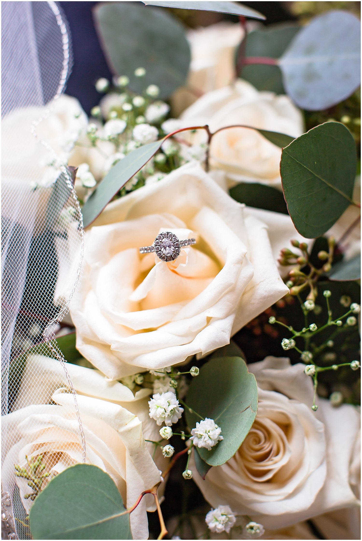 detail shot of the wedding bouquet and wedding rings