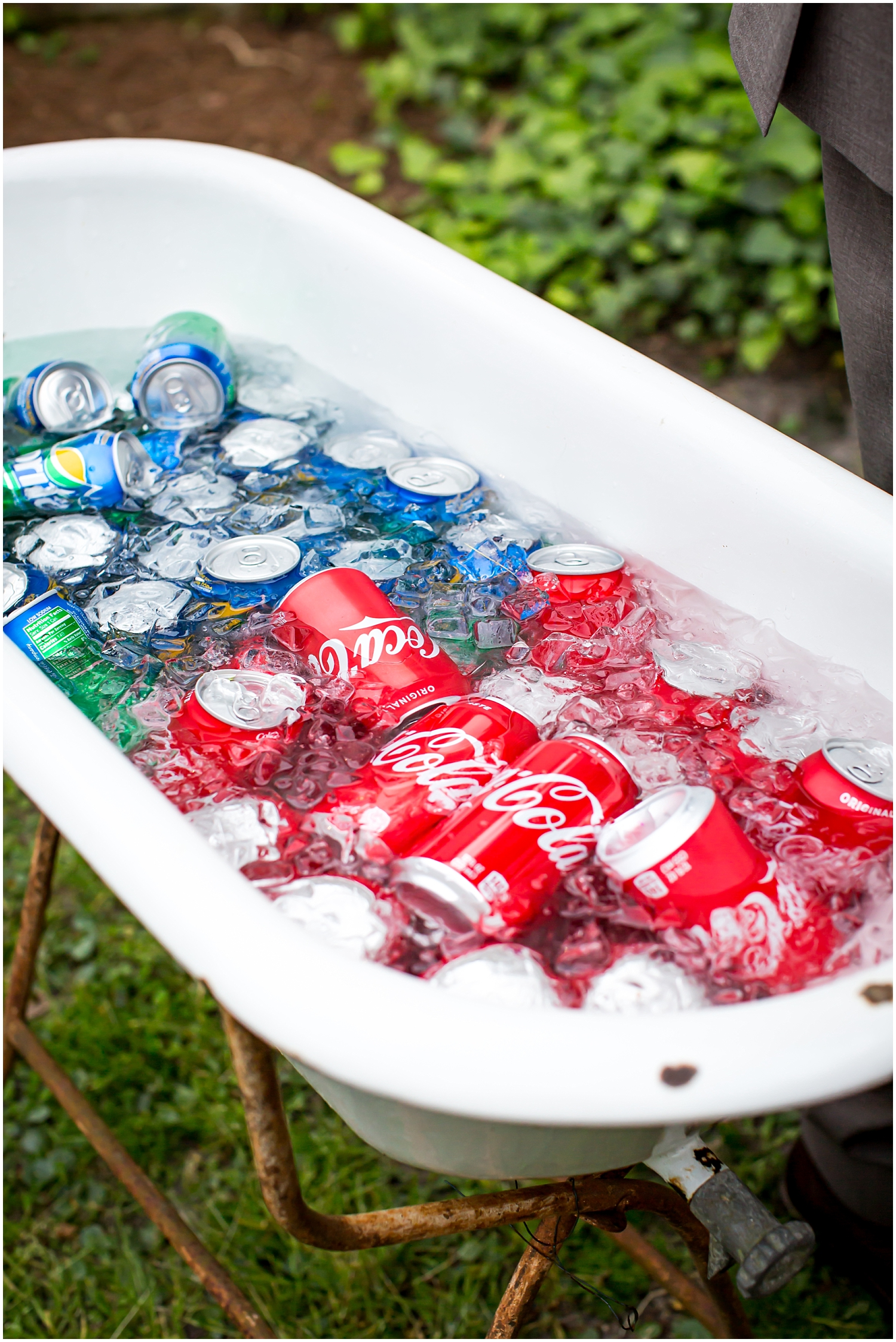 bath tub filled with soda cans