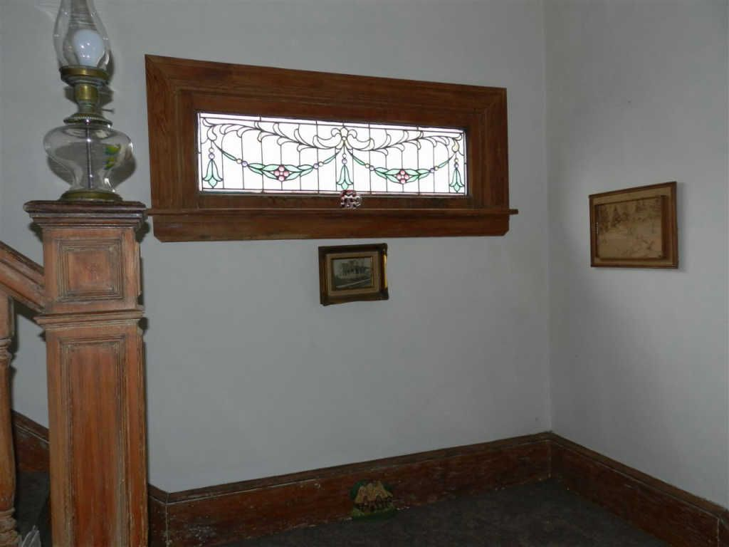 Prerequisite stained glass window in entry hall.