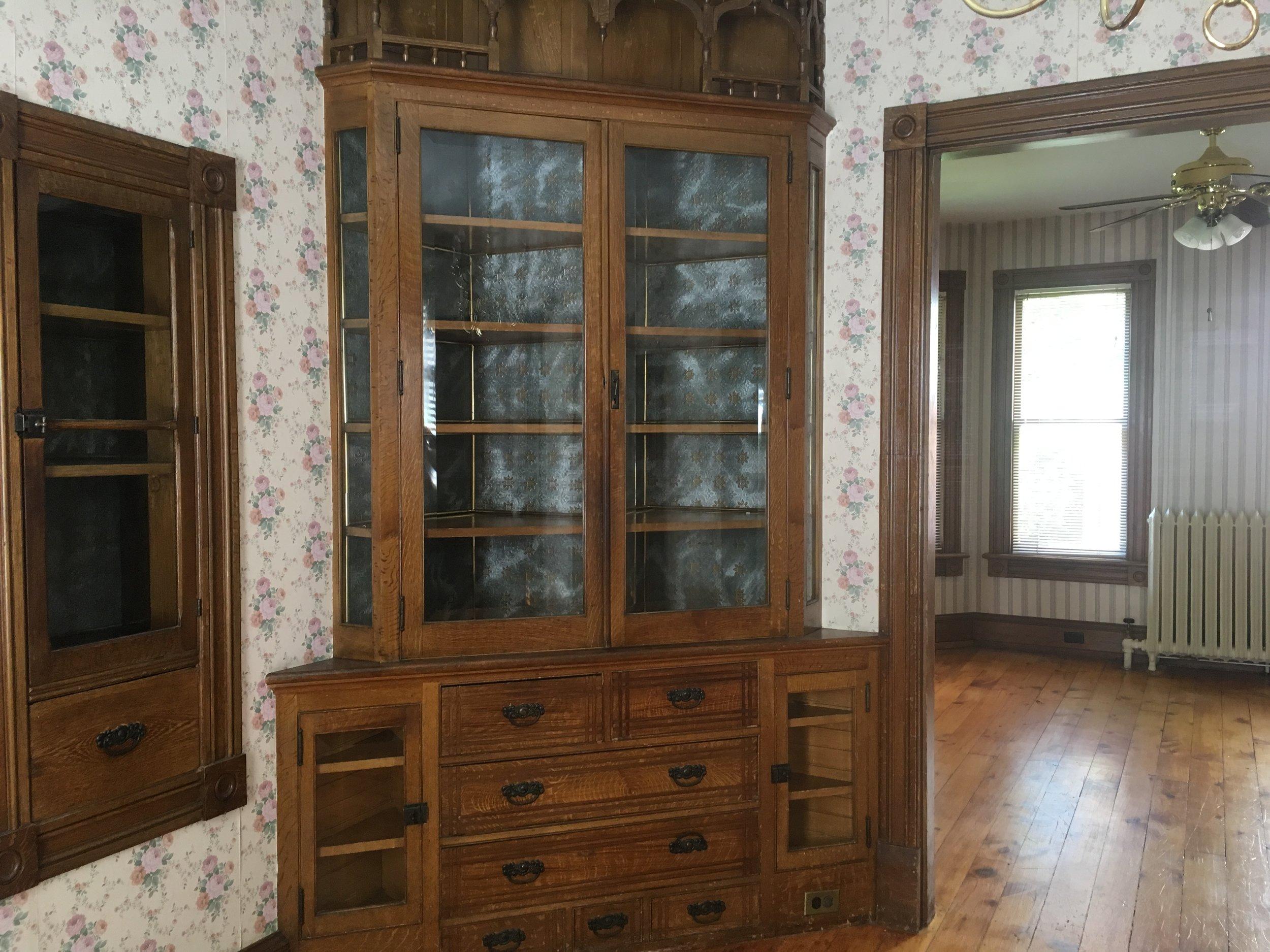 Built-ins, wallpaper, woodwork, wood floors, radiators, all the good stuff.