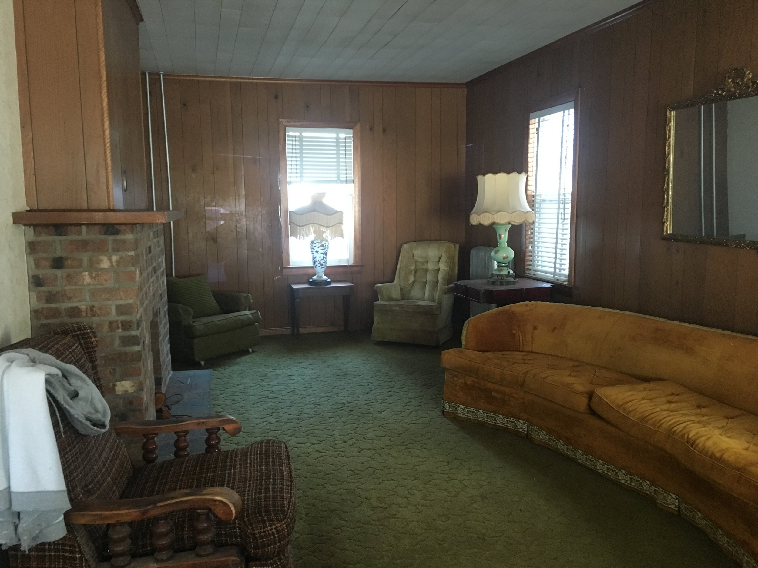 Awesome interior blends a mix of 1920s and 1970s.