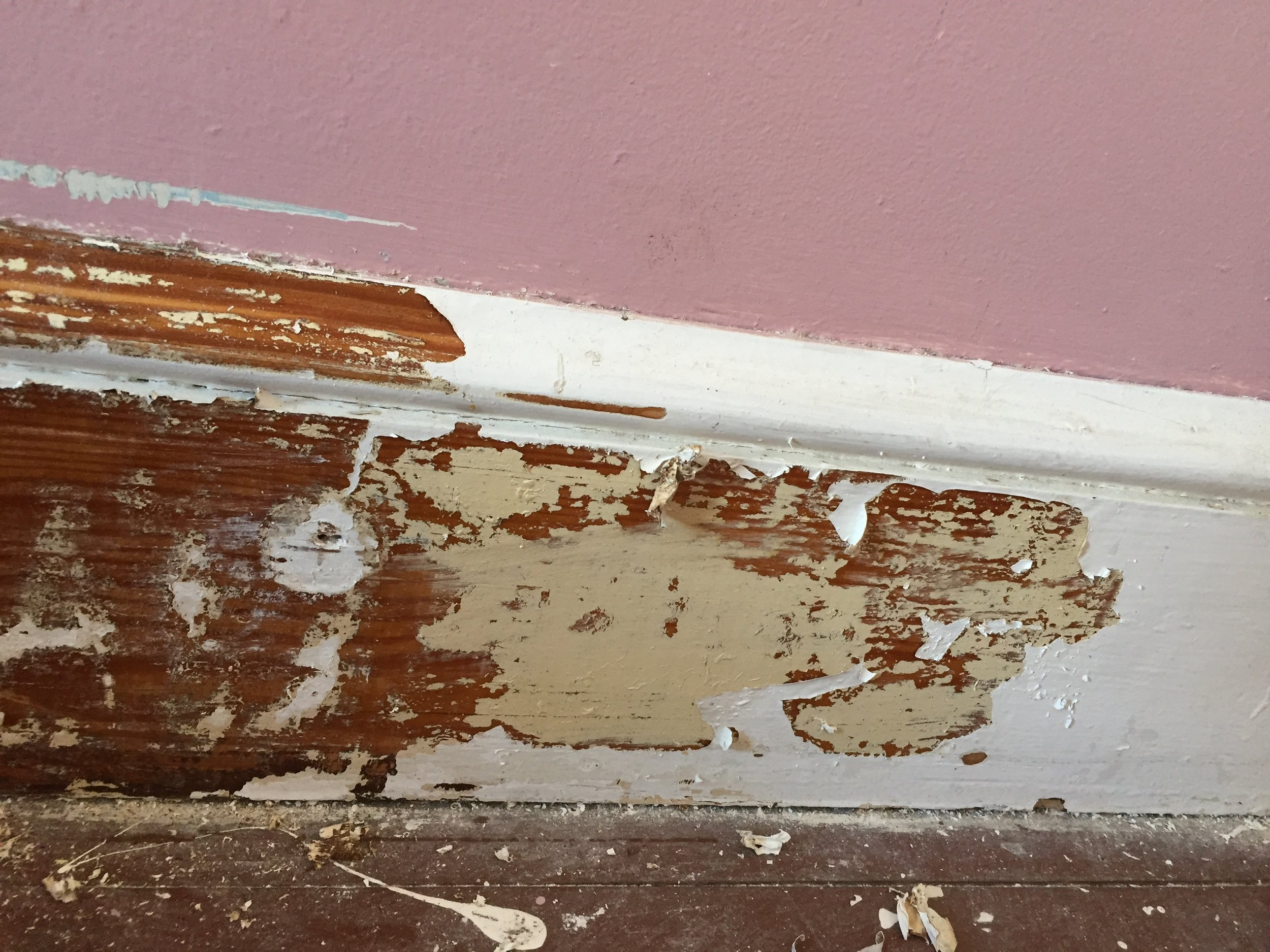 The top layer is modern oil-based paint. The middle layer is lead paint. The last layer is the original shellac finish.