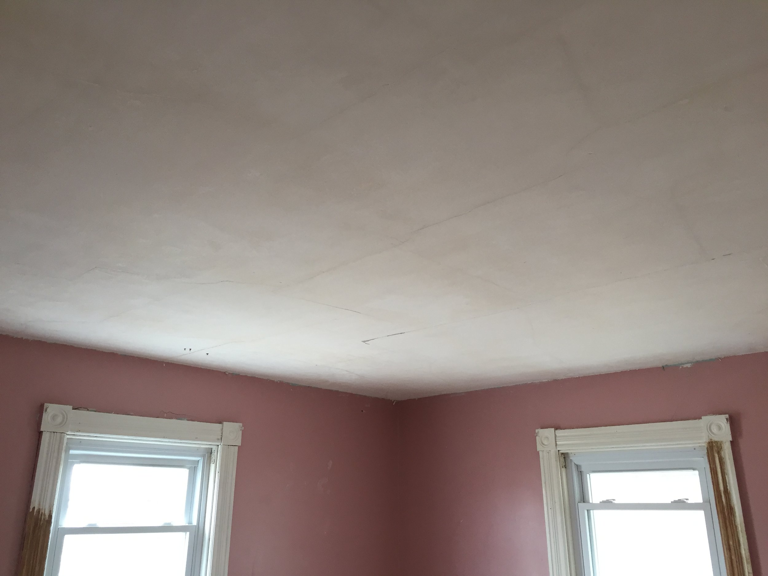 Ceiling is getting clean. All popcorn removed and now can see the original plaster.