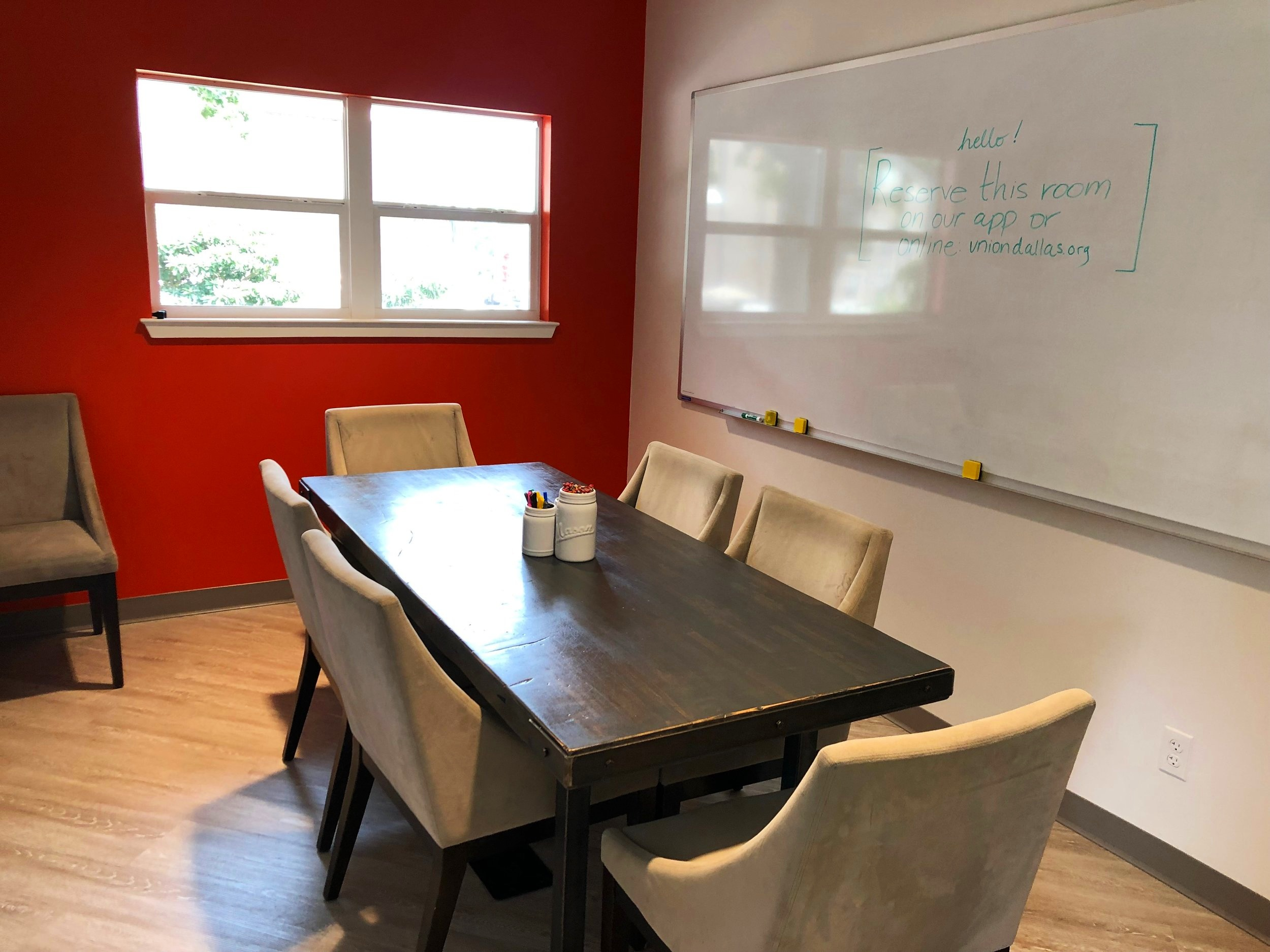 Upstairs Conference Room - Seating for 6-8, flatscreen with Apple TV, and a huge whiteboard for all your brilliant ideas! $20/hr.
