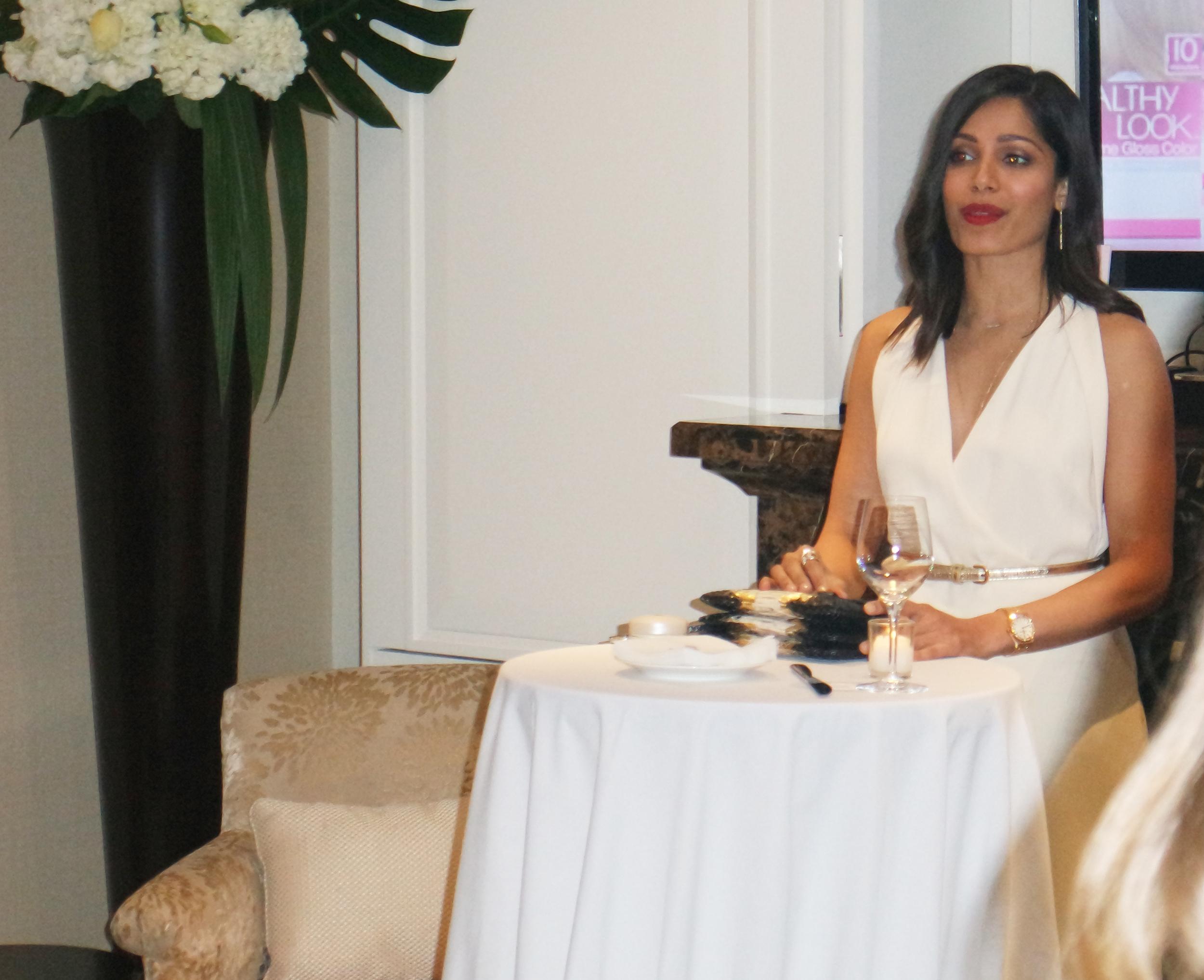 Freida Pino making a speech