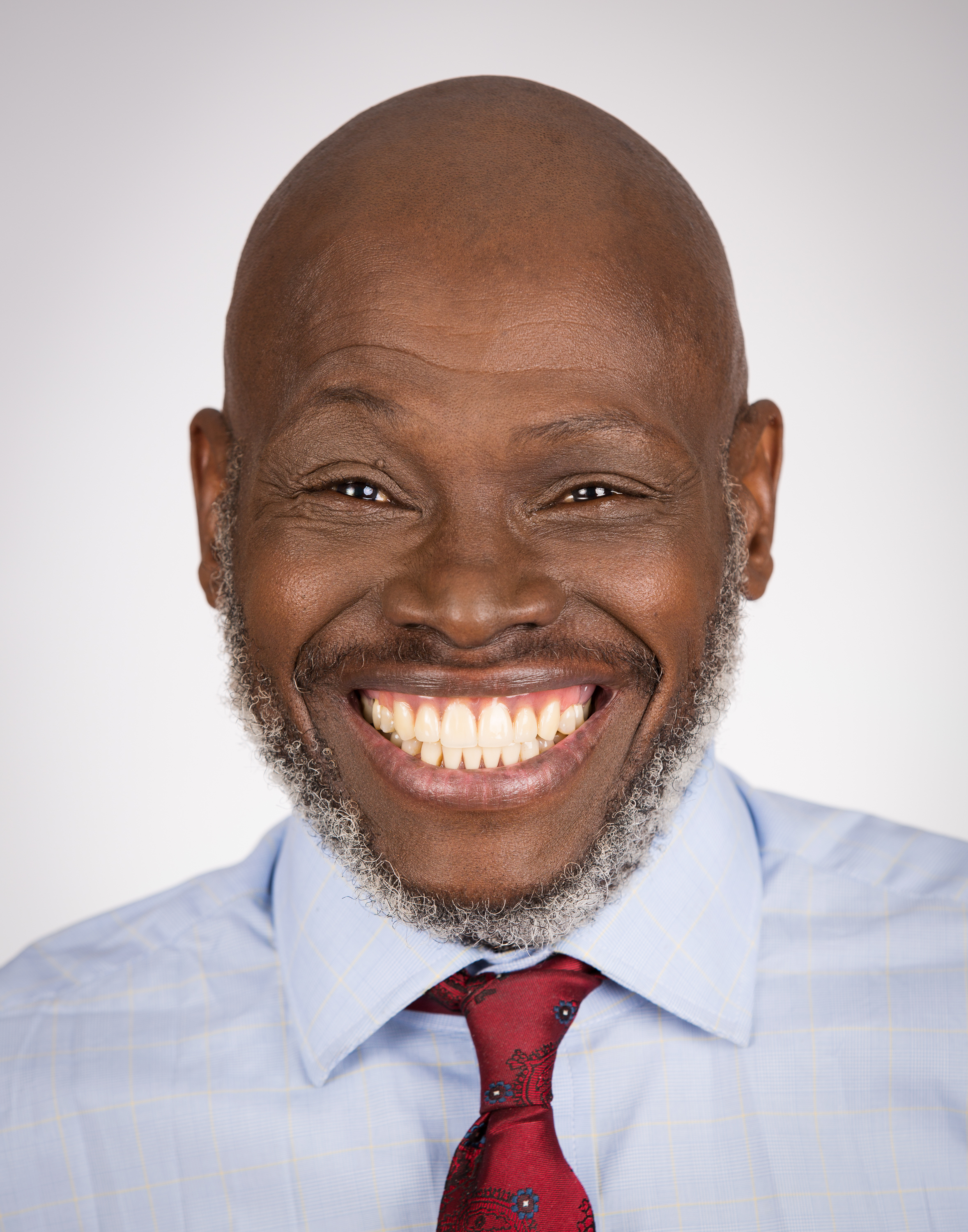 One of my favorite smiles! This portrait was taken for a dental office in Evanston, IL. This happy man is one of their patients and is clearly excited to be showing off his dental work. Makes me excited to go to the dentist!
