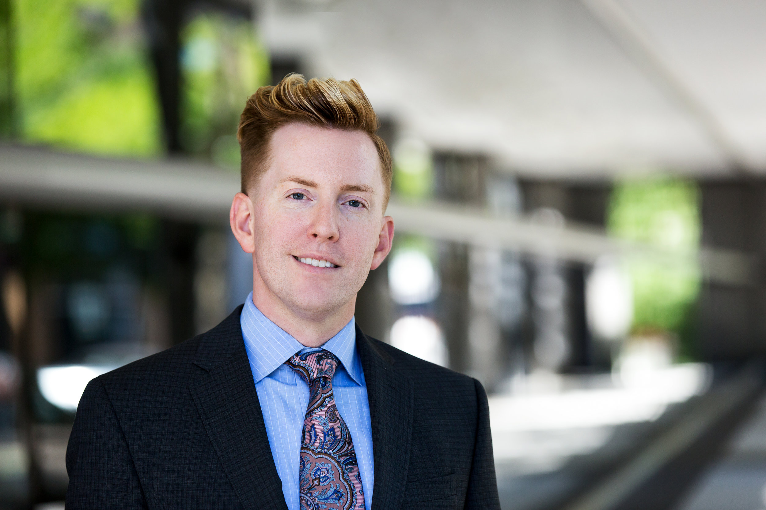 Here's an example of a corporate headshot taken outside of a professional office building. This environment provided us with a slightly more unique and natural look, while still looking professional.