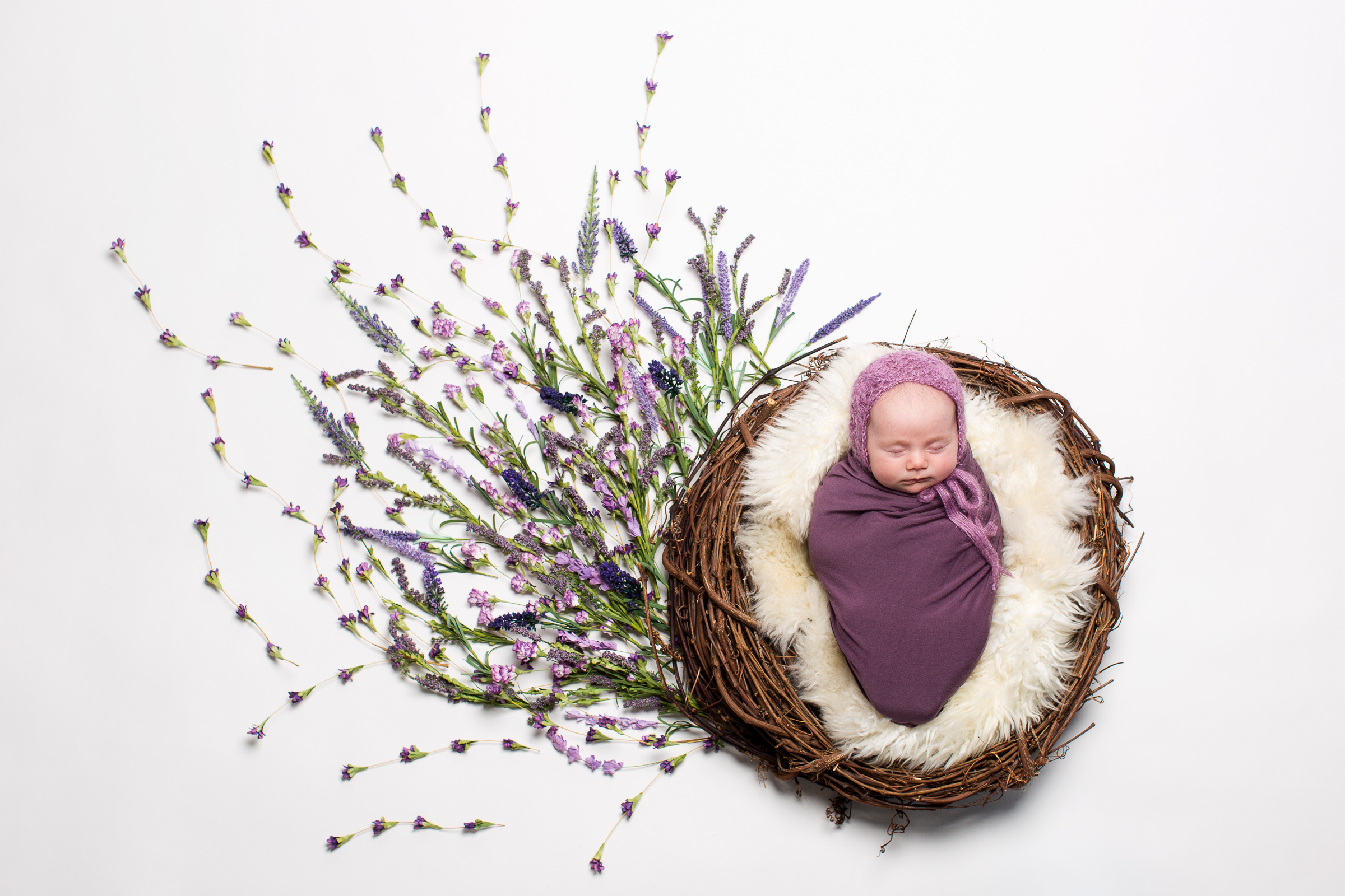 Newborn - Custom crafted newborn baby sessions freeze time during the first couple of weeks of your baby's journey.
