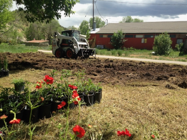 Breaking ground at our Rio Grande Artway garden site behind the clay center with a little help from the RFTA trail manager.