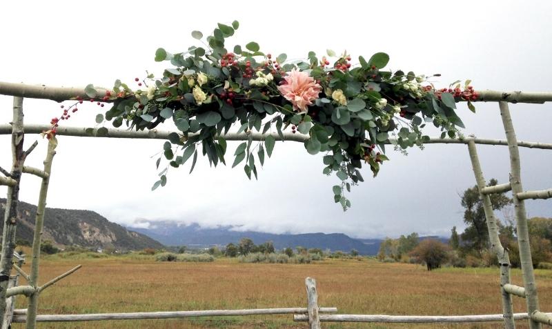 Arbor arrangement dahlia, rose hips, eucalyptus, spray roses.