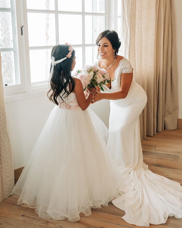 Such a sweet candid mother daughter moment right before this stunning bride walked down the aisle .......