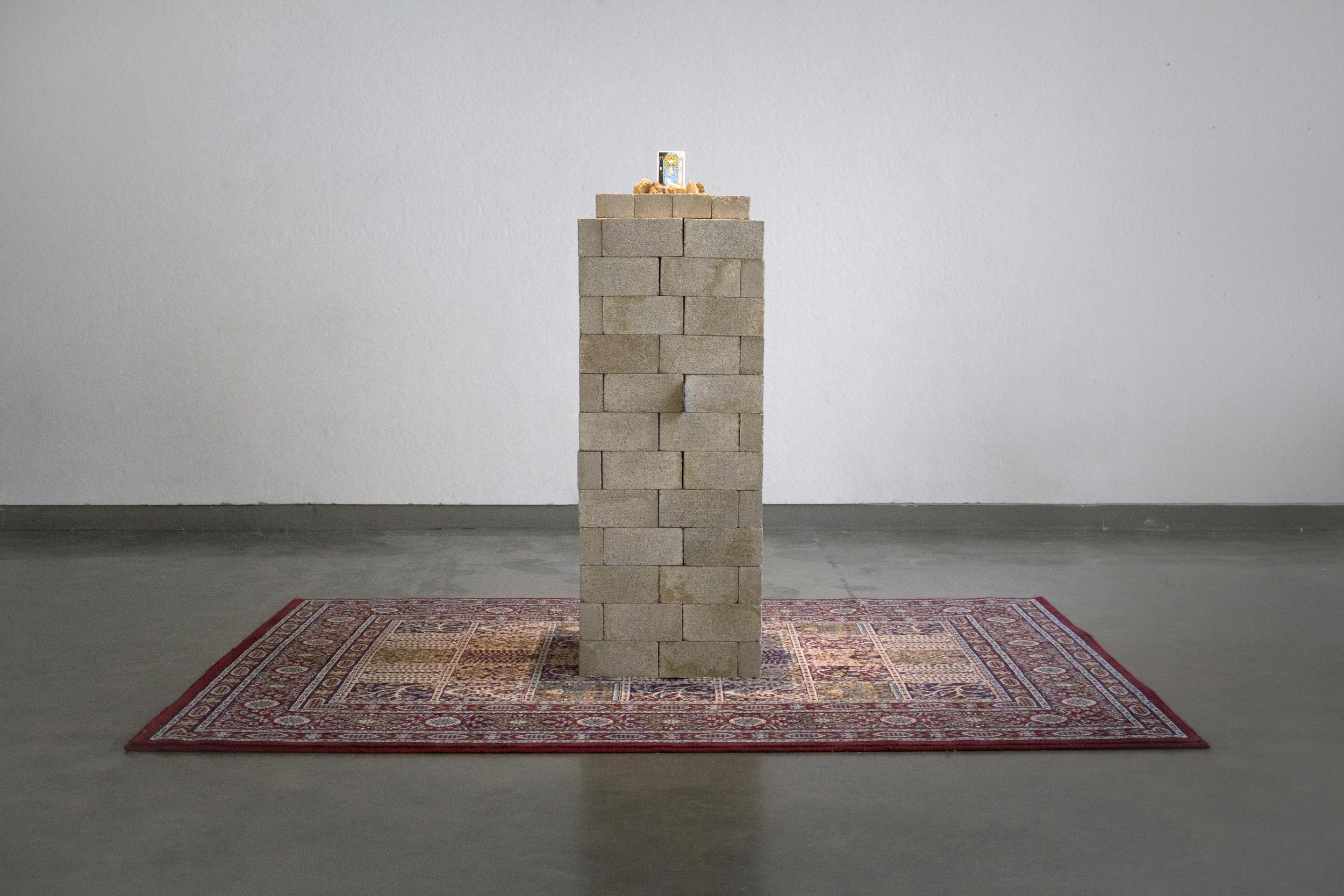 "Monumentum:  65x67x91""  rug, bricks, rocks, tarot cards"