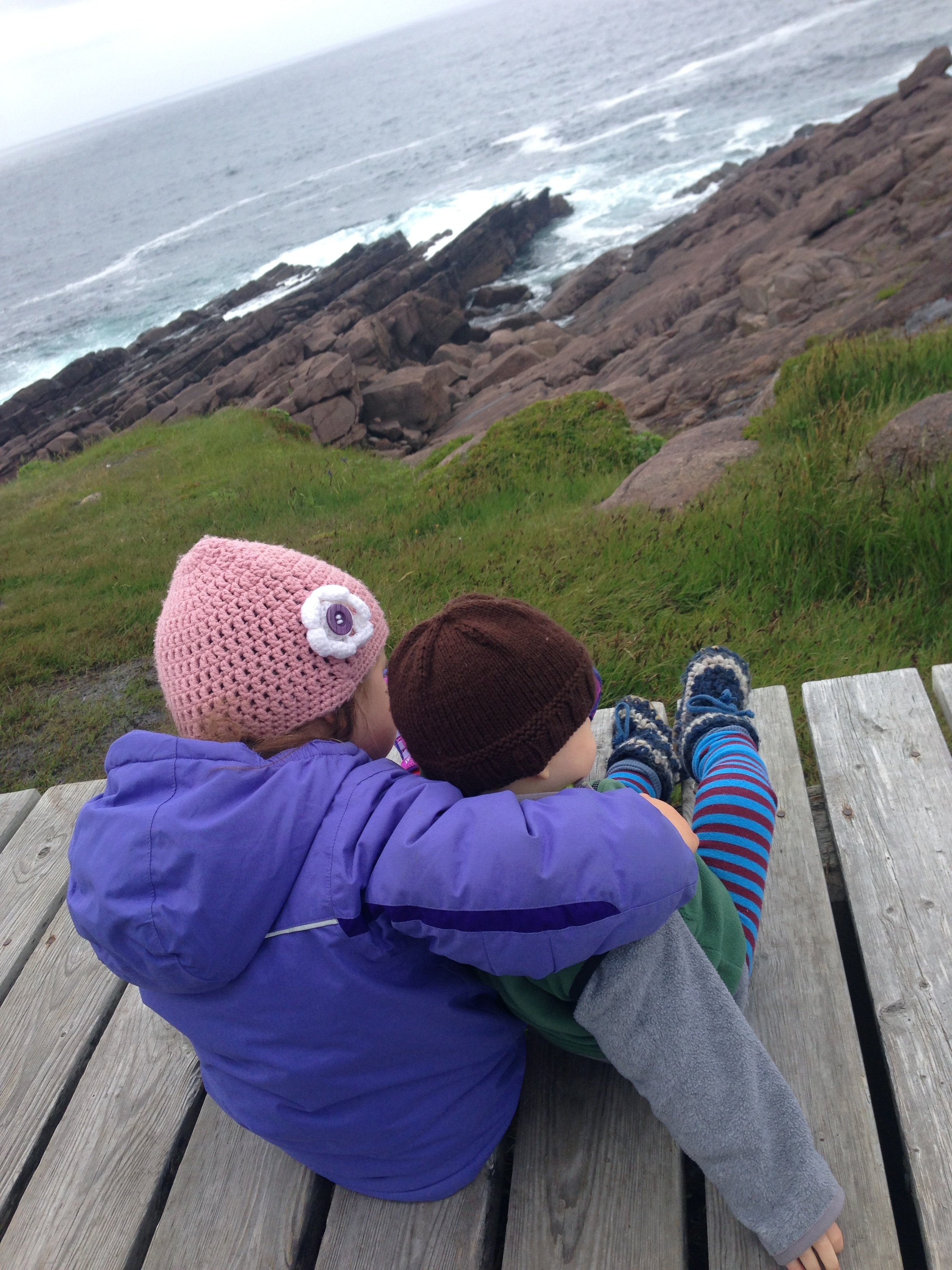 Buddies watching the waves at Cape Spear, Newfoundland.