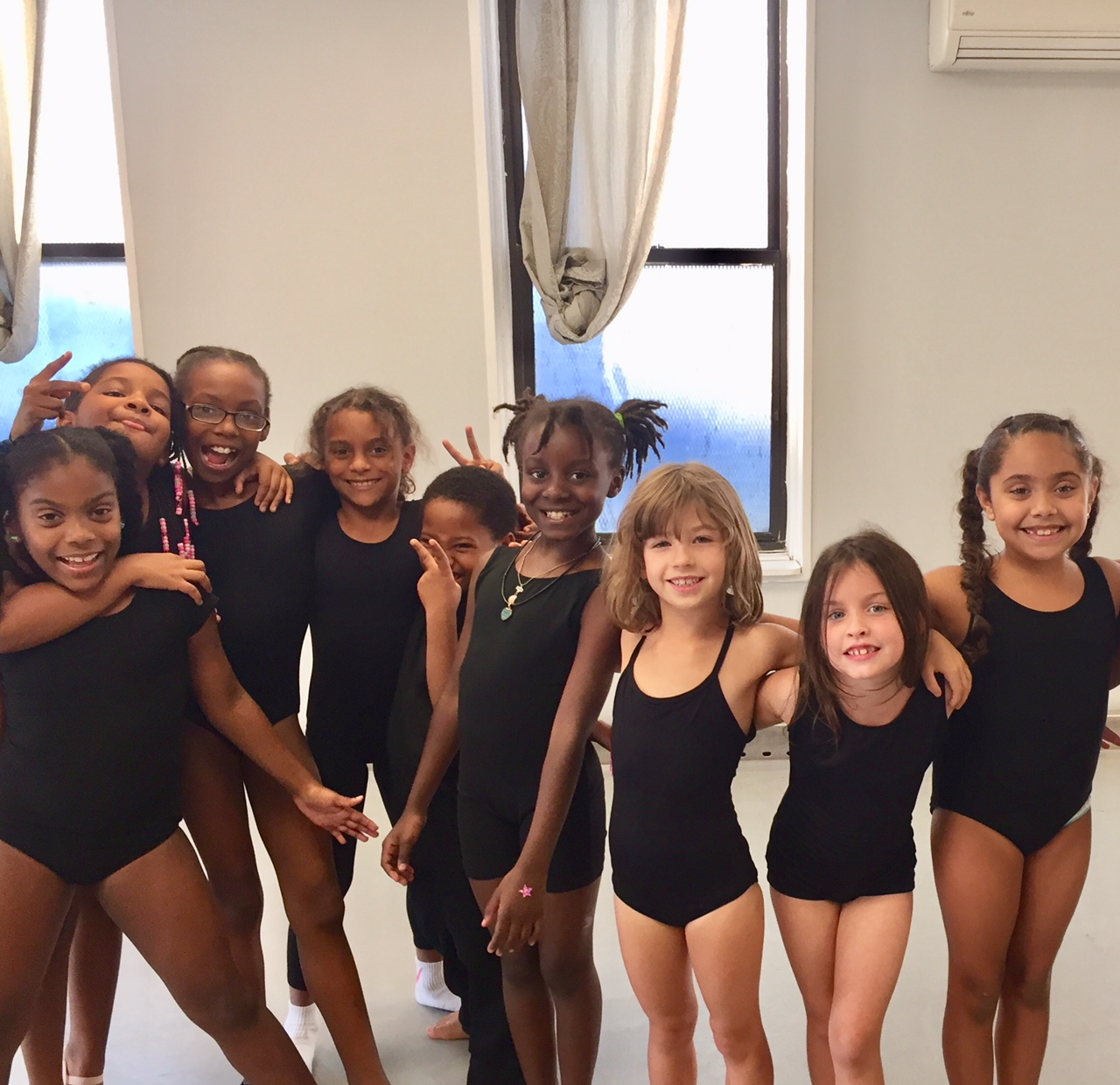 Modern 2 students get silly before class. Dance classes are not only places to learn to leap and turn, they are places where lasting bonds are made and self-confidence, creativity, and meaningful relationships flourish. Your donation gives that to a child!