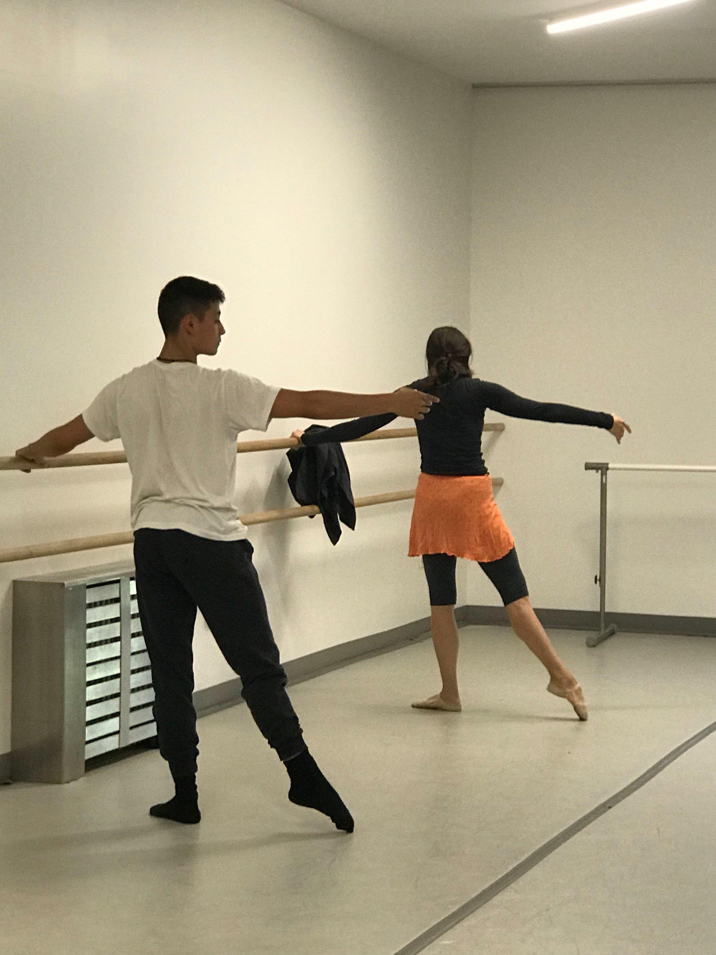 Ballet teacher Elyssa Dole demonstrates for student Mateo Vidals.