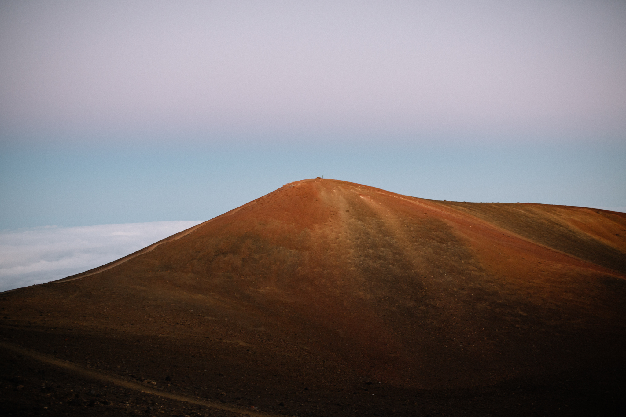 The actual summit, pictured here, is a historic and religiously significant site for native Hawaiians. Hiking to it is forbidden.