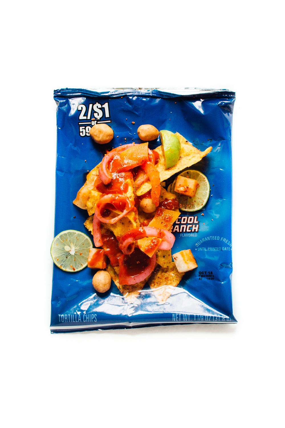 Cool Ranch Doritos, Japanese peanuts, pickled red onion, dried mango, salsa Valentina, jicama, shredded cucumber, Tajín