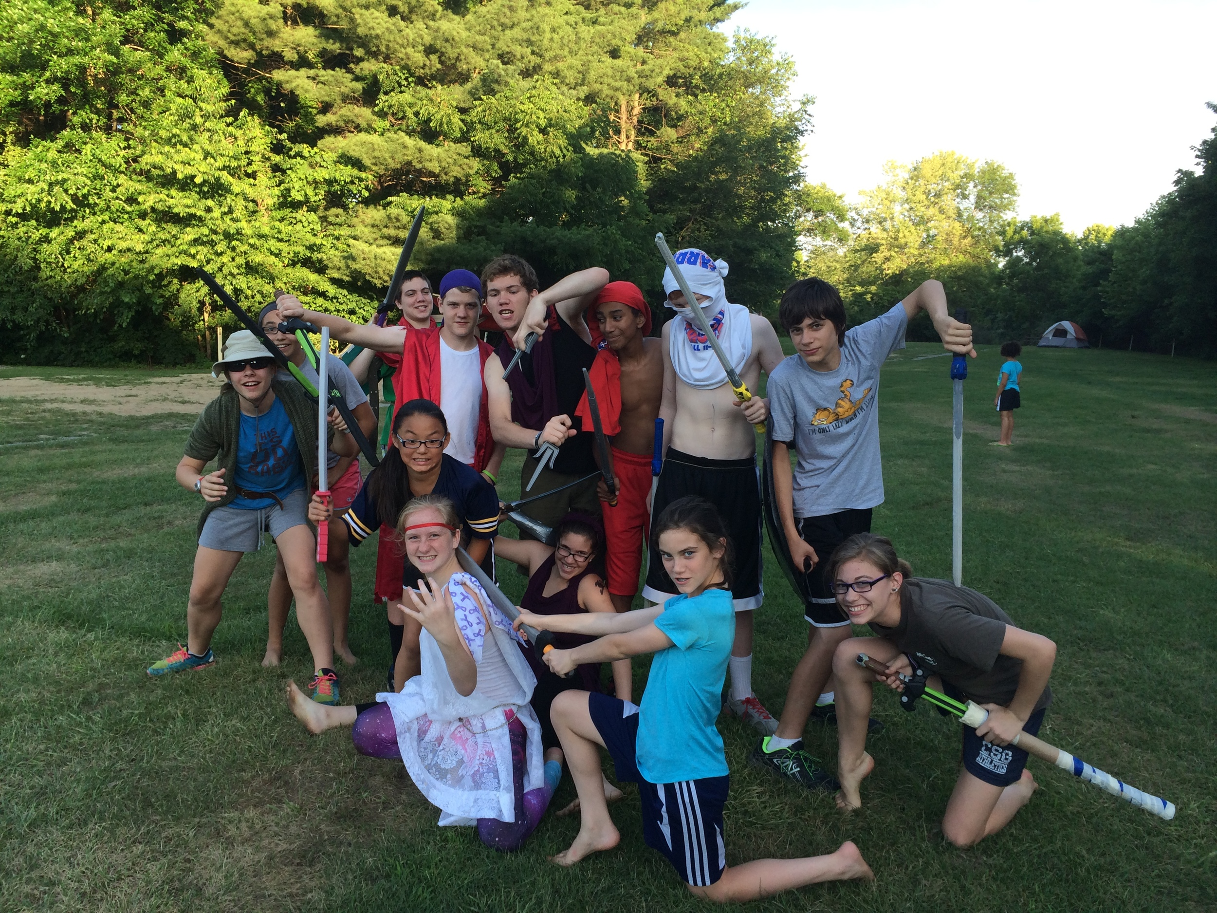 The kids LARPing, family campout 2014